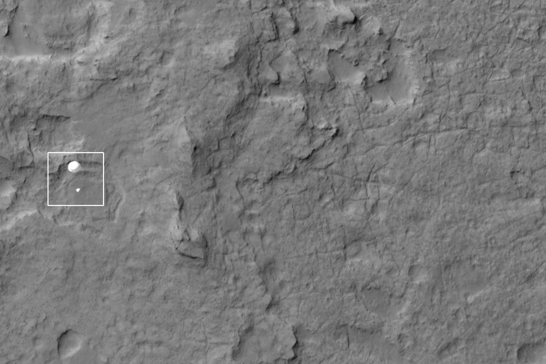 NASA's Curiosity rover and its parachute are seen by NASA's Mars Reconnaissance Orbiter as Curiosity descends to the surface around 10:32 p.m. PDT, Aug. 5, or 1:32 a.m. EDT, Aug. 6, 2012.  The rover is equipped with a nuclear-powered lab capable of vaporizing rocks and ingesting soil, measuring habitability, and whether Mars ever had an environment able to support life.