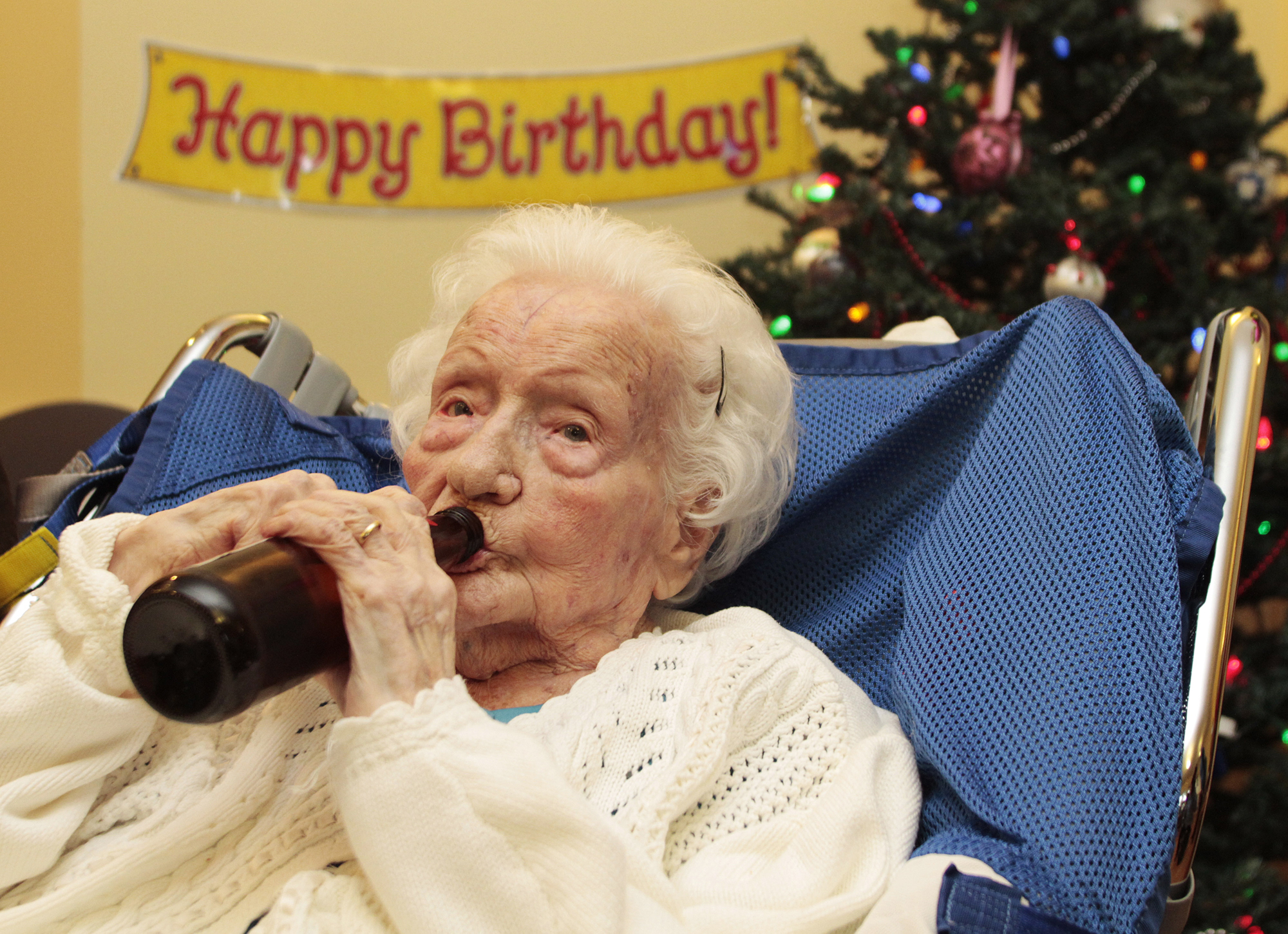 Merle Barwis, photographed at 111 years old, enjoys a birthday beer with family in Victoria, B.C. December 23, 2011. She is now 113.
