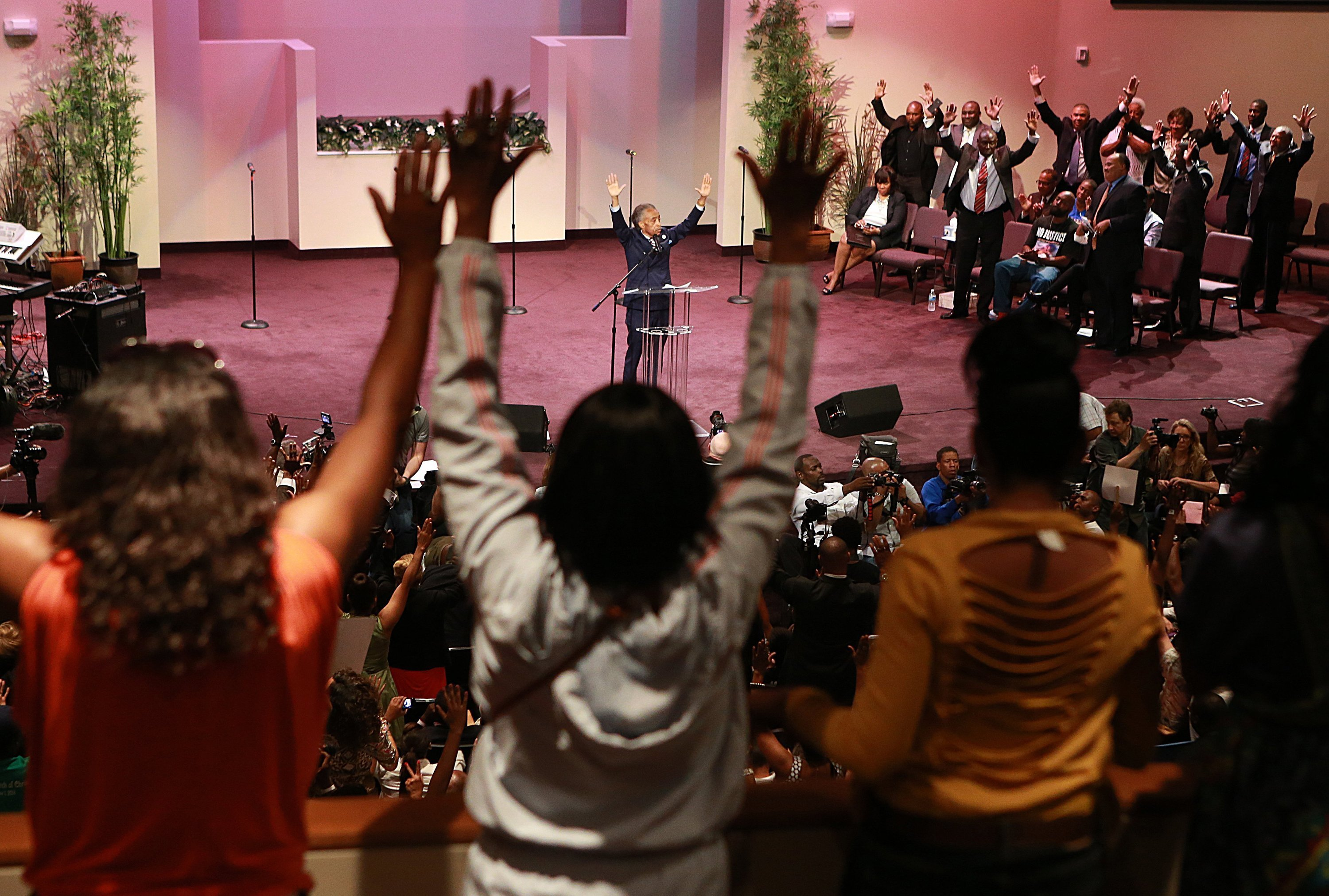 Rev. Al Sharpton speaks during a rally for justice for Michael Brown at Greater Grace Church in Ferguson, Mo., on Aug. 17, 2014.