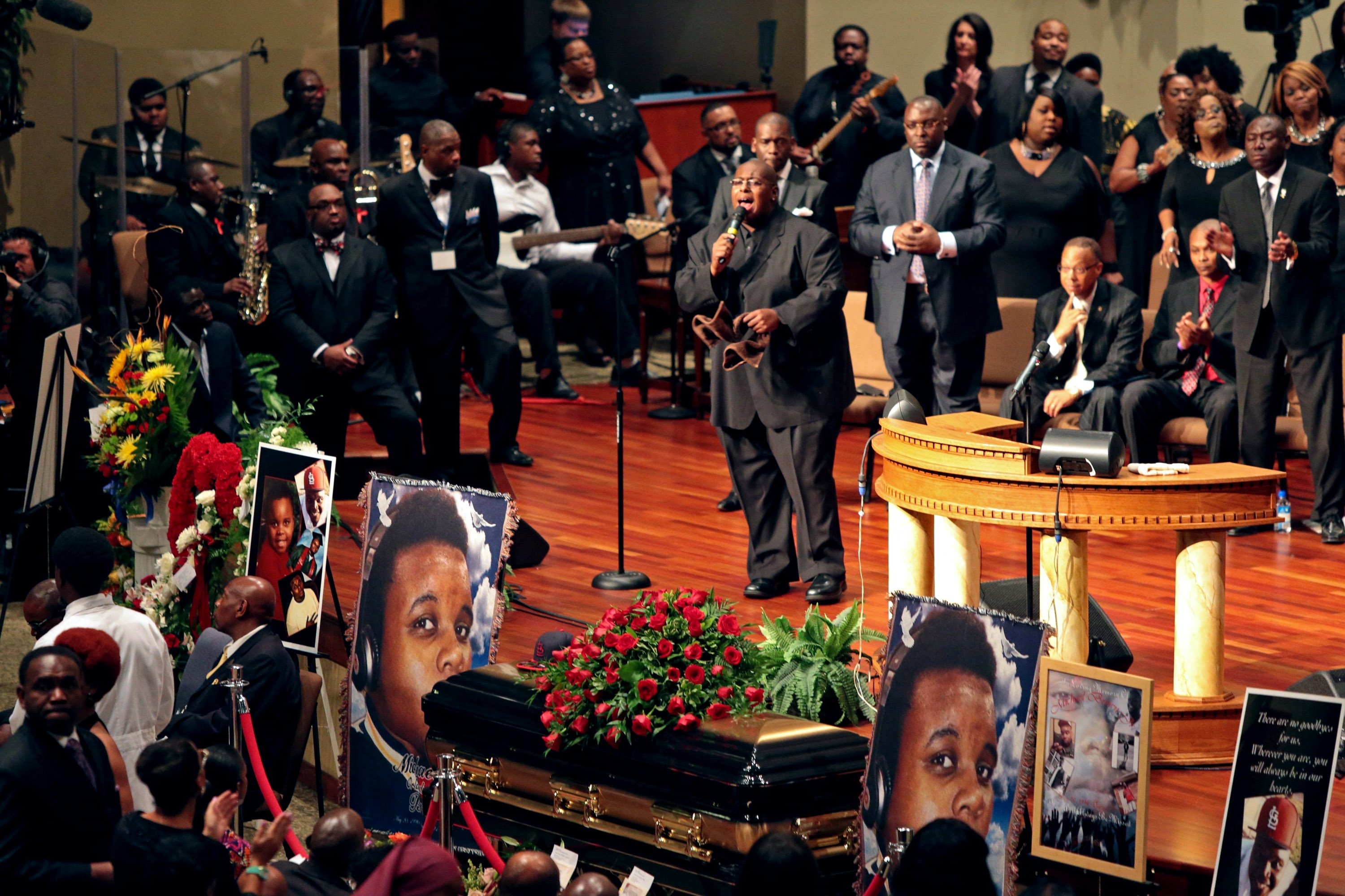 People attend the funeral of Michael Brown inside the Friendly Temple Missionary Baptist Church in St. Louis on Aug. 25, 2014.