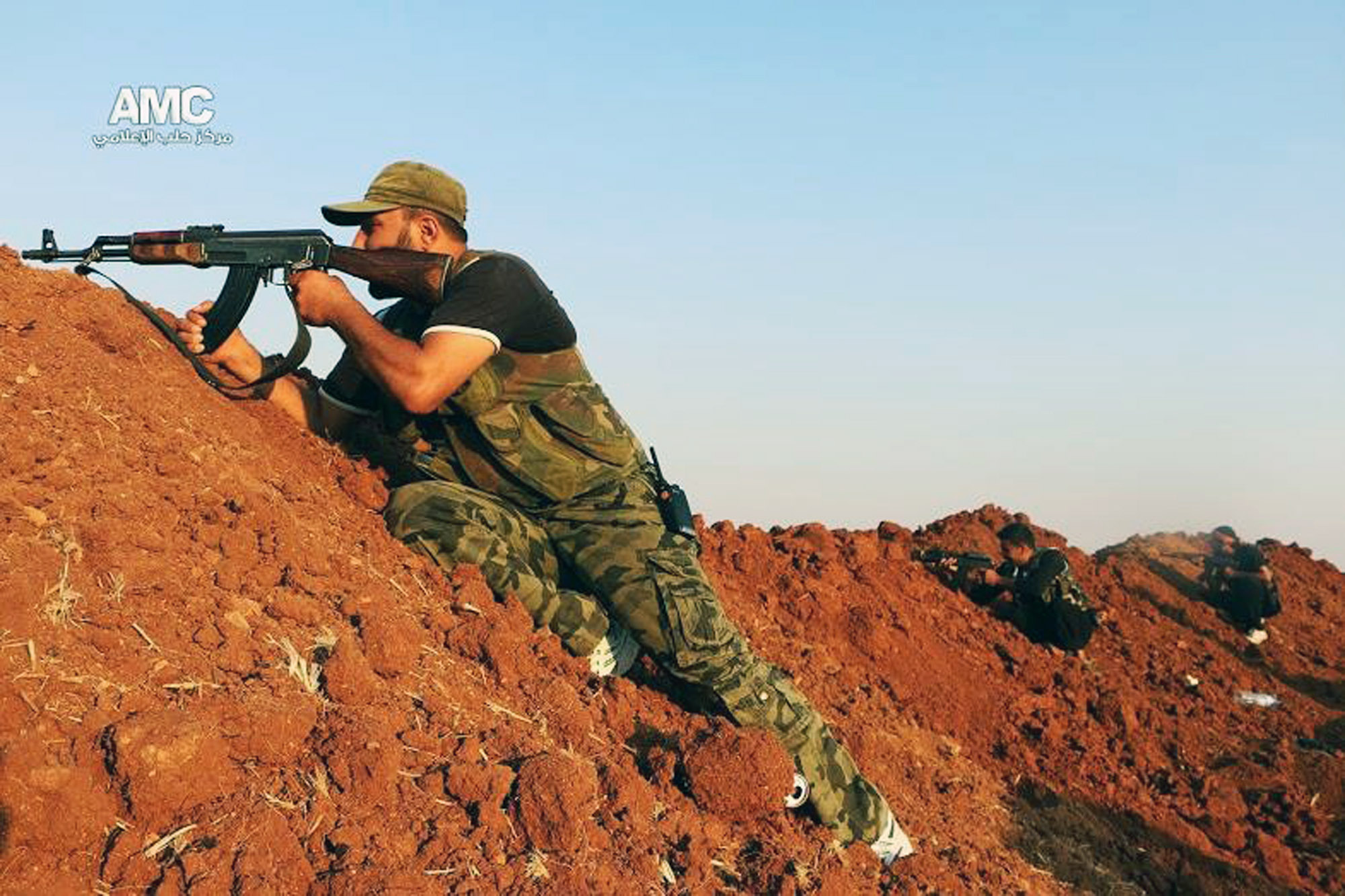 A photo provided by the antigovernment activist group Aleppo Media Center shows a Free Syrian Army fighter aiming his weapon during a battle with Islamic State militants in Aleppo, Syria, on Aug. 17, 2014