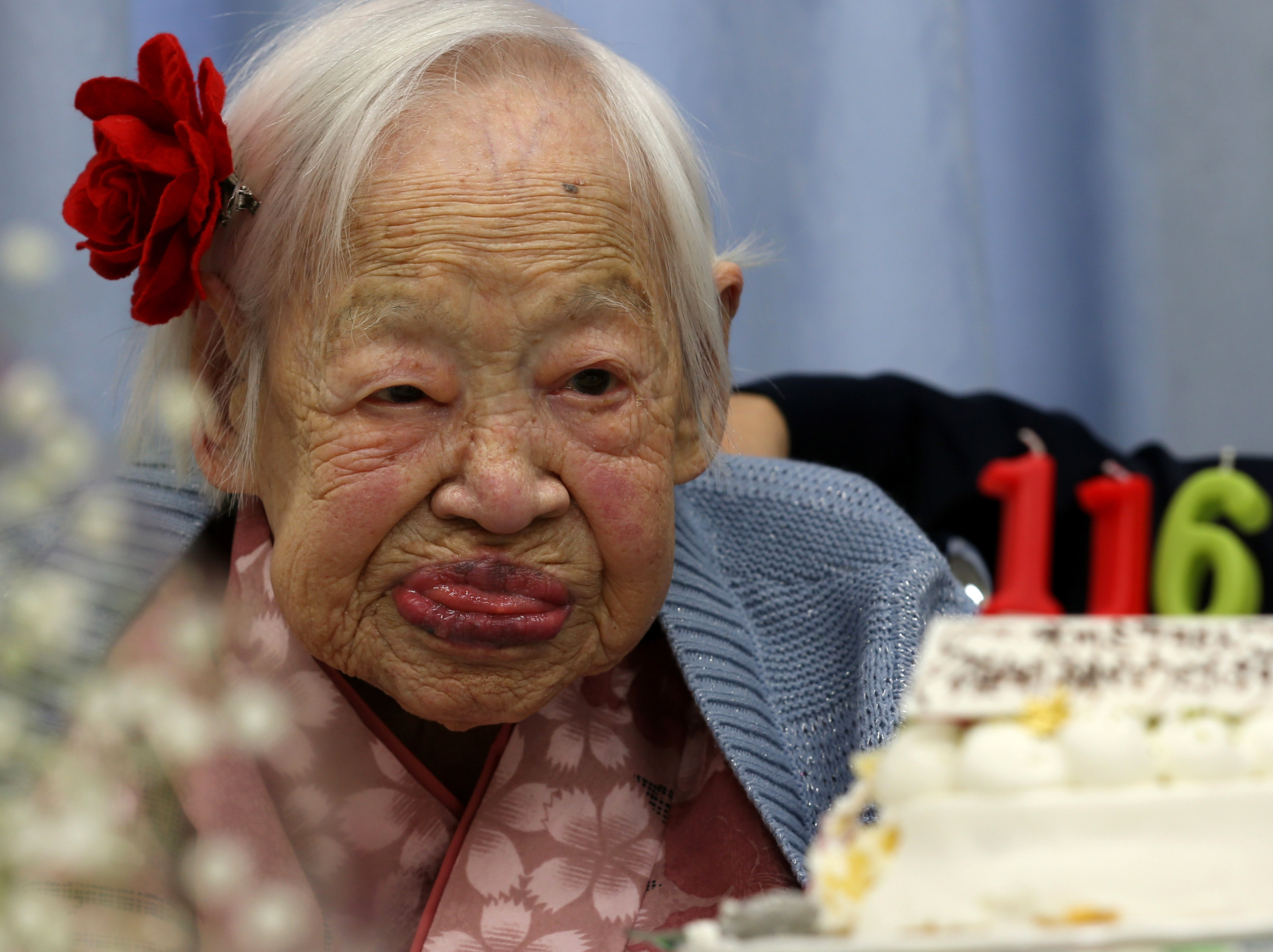 Misao Okawa, the world's oldest living person, looks on her 116th birthday celebration at Kurenai Nursing Home on March 5, 2014 in Osaka, Japan. Okawa, born in Tenma, Osaka, on March 5, 1898 to a family of Kimono merchants, married in 1919 and had three children, of which a daughter and a son are still alive, and has four grandchildren and six great-grandchildren. Okawa is currently 116 years old.