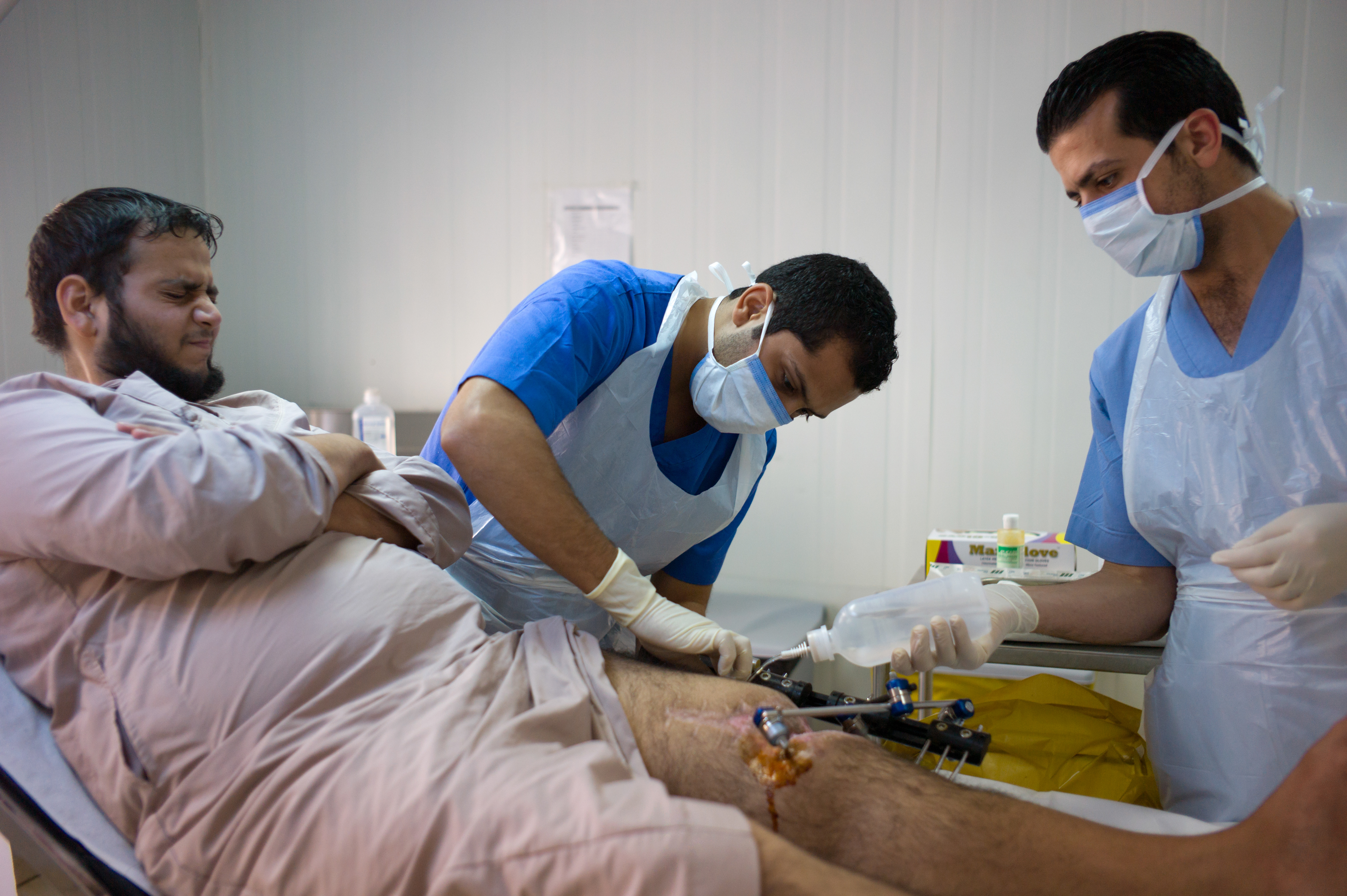 A Syrian refugee is treated by Doctors Without Borders' staff