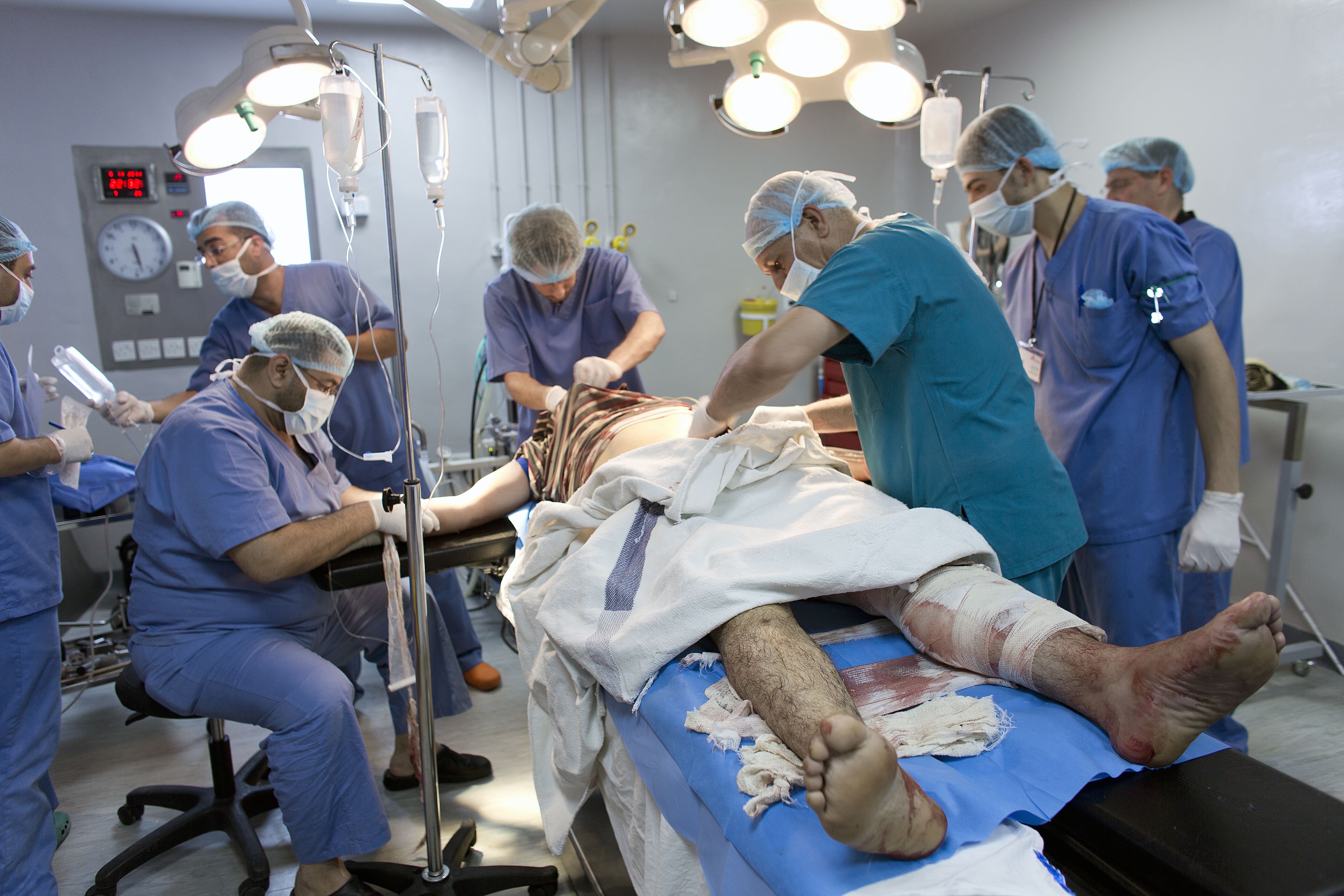 MSF staff working in the Ramtha hospital in Jordan, where war wounded patients from Syria are being treated. Doctors Without Borders' medical staff is operating a patient in the operation theater.