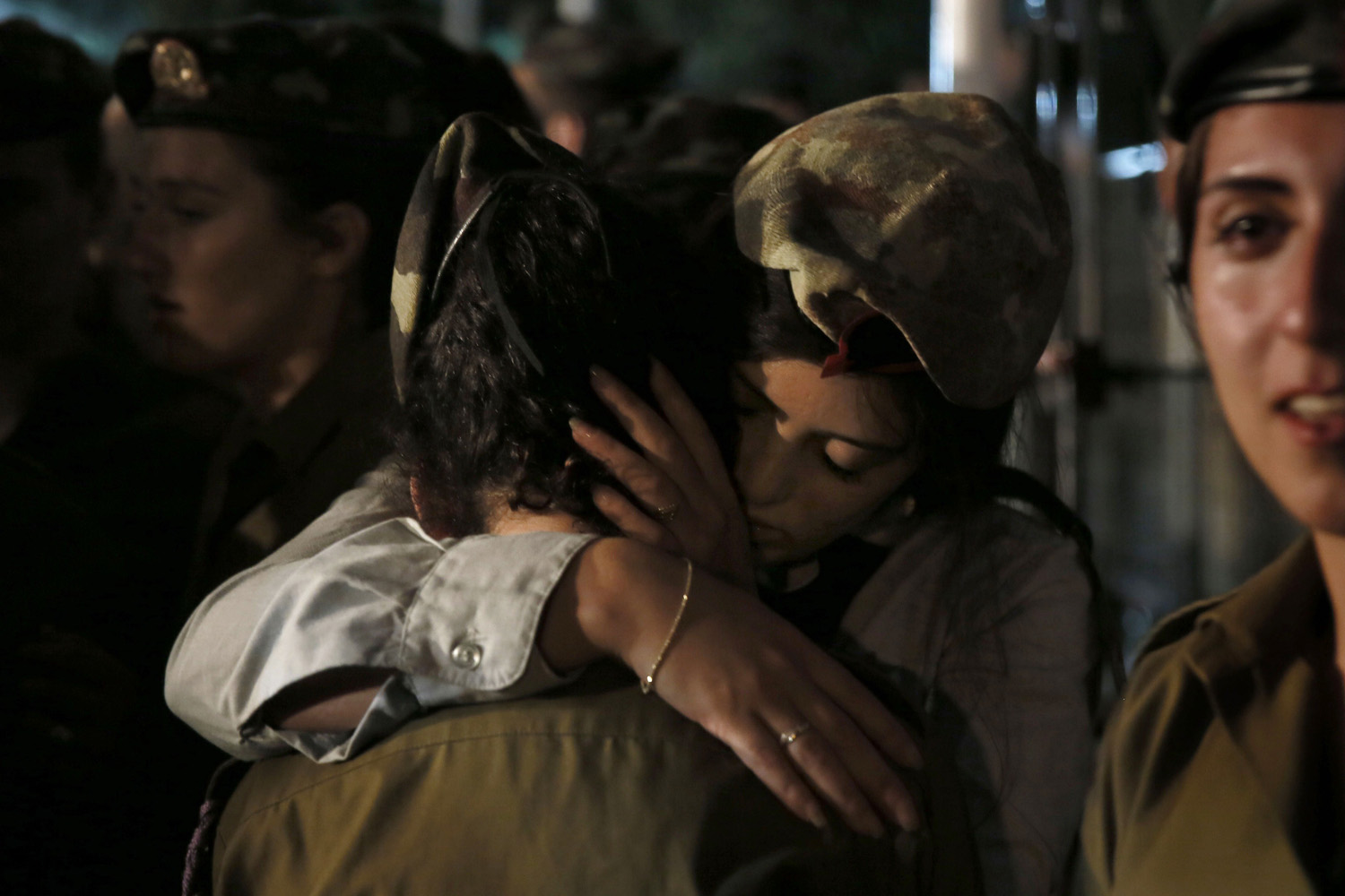 Jul. 29, 2014. Females comrades of 21-year-old Israeli Sgt. Barkey Ishai Shor, mourn during his funeral at the Mount Herzel military cemetery in Jerusalem, after he was killed the previous day in combat.