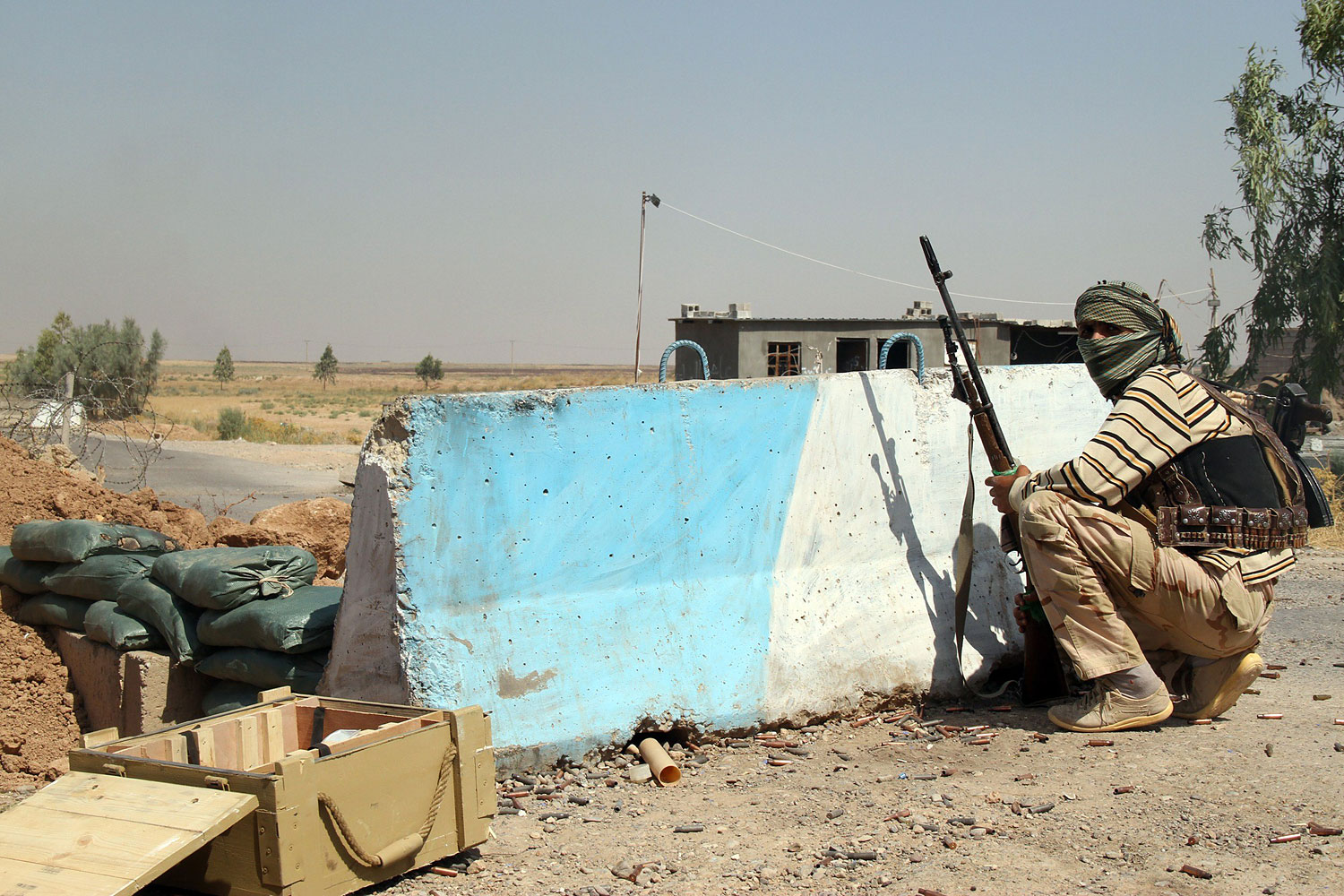 An Iraqi Turkmen Shi'ite fighter holds a position on Aug. 4, 2014 in Amirli, Iraq