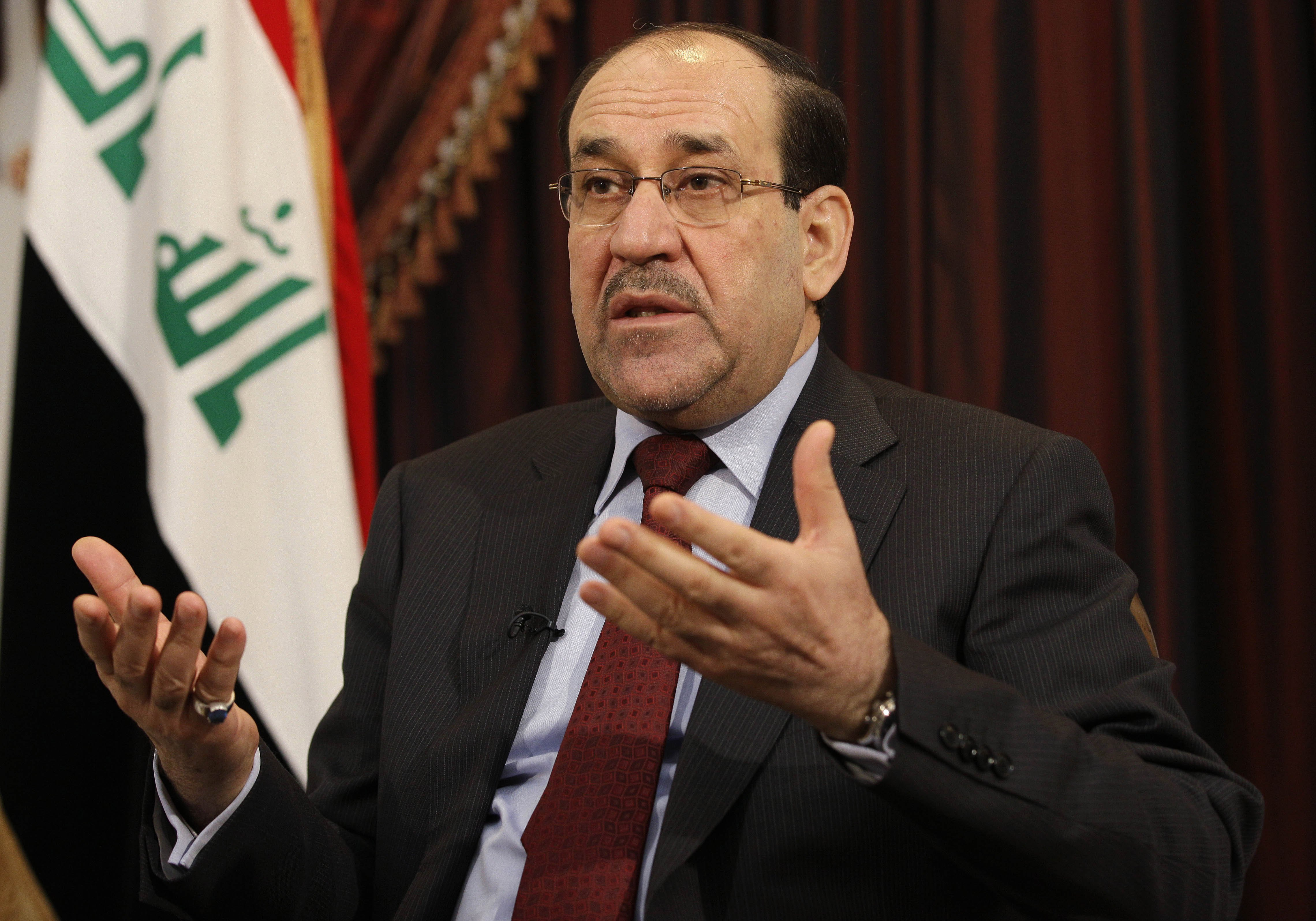 Iraq's Prime Minister Nouri al-Maliki speaks during an interview with the Associated Press in Baghdad on Dec. 3, 2011