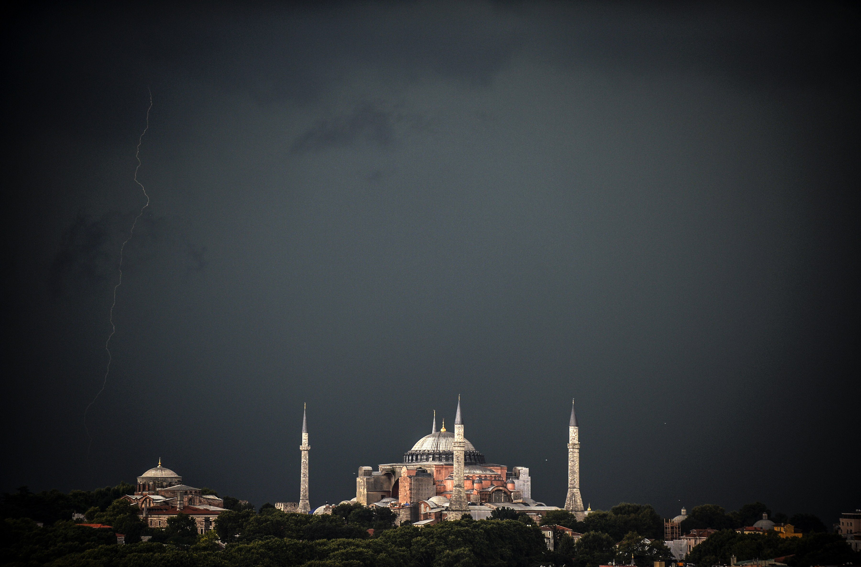 Aug. 7, 2014. Clouds gather over the Hagia Sophia museum during a storm in Istanbul as ligntning plays across the sky.