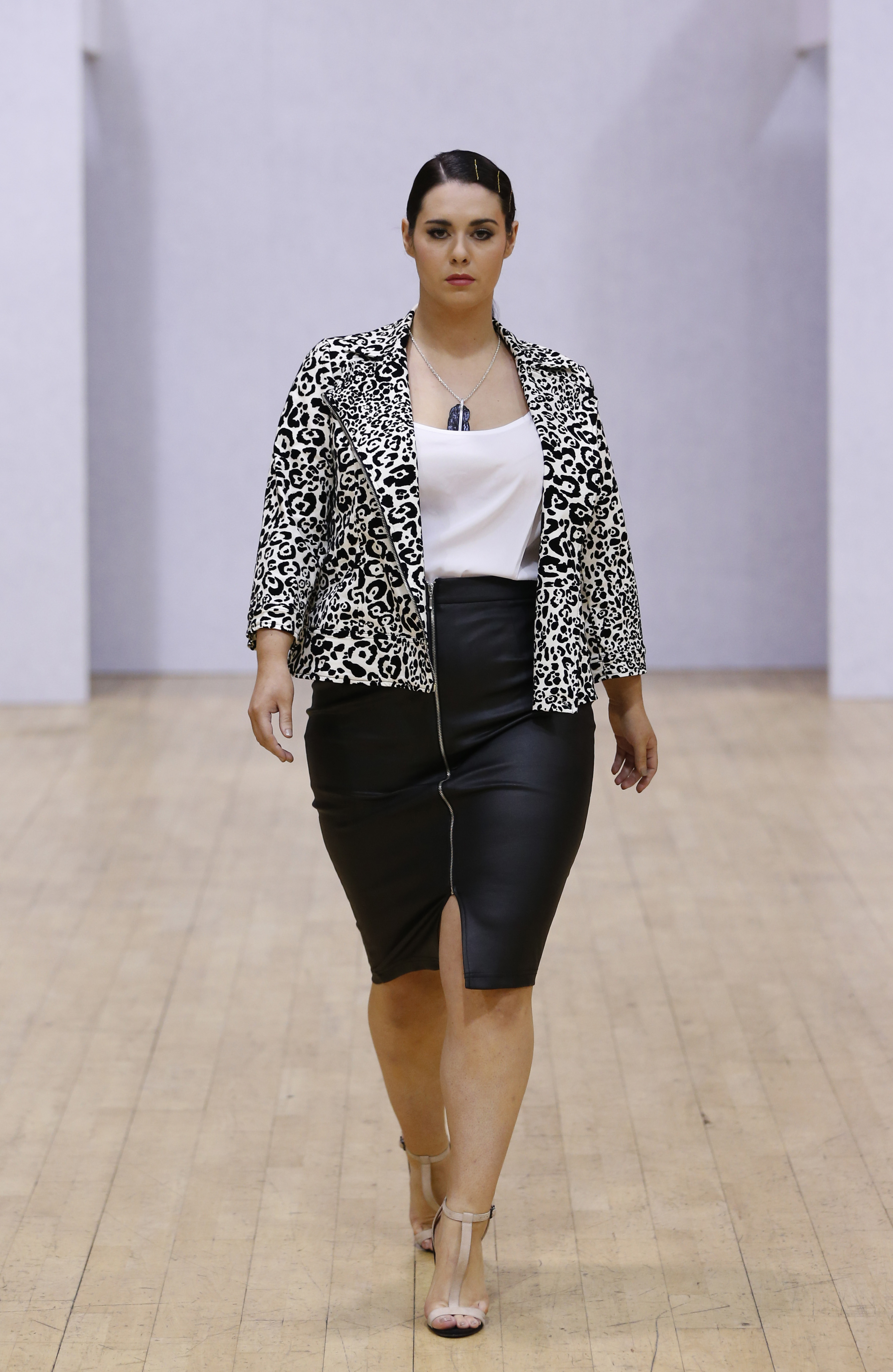 A model walks the runway at the British Plus-size Fashion Weekend show during London Fashion Week last winter.