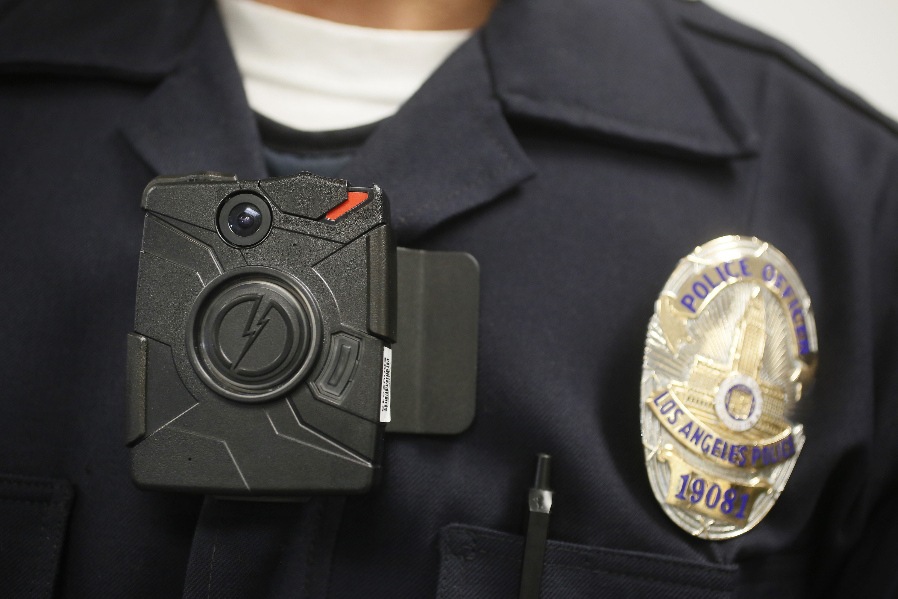 A Los Angeles Police officer wears an on-body camera during a demonstration for media on Jan. 15, 2014.