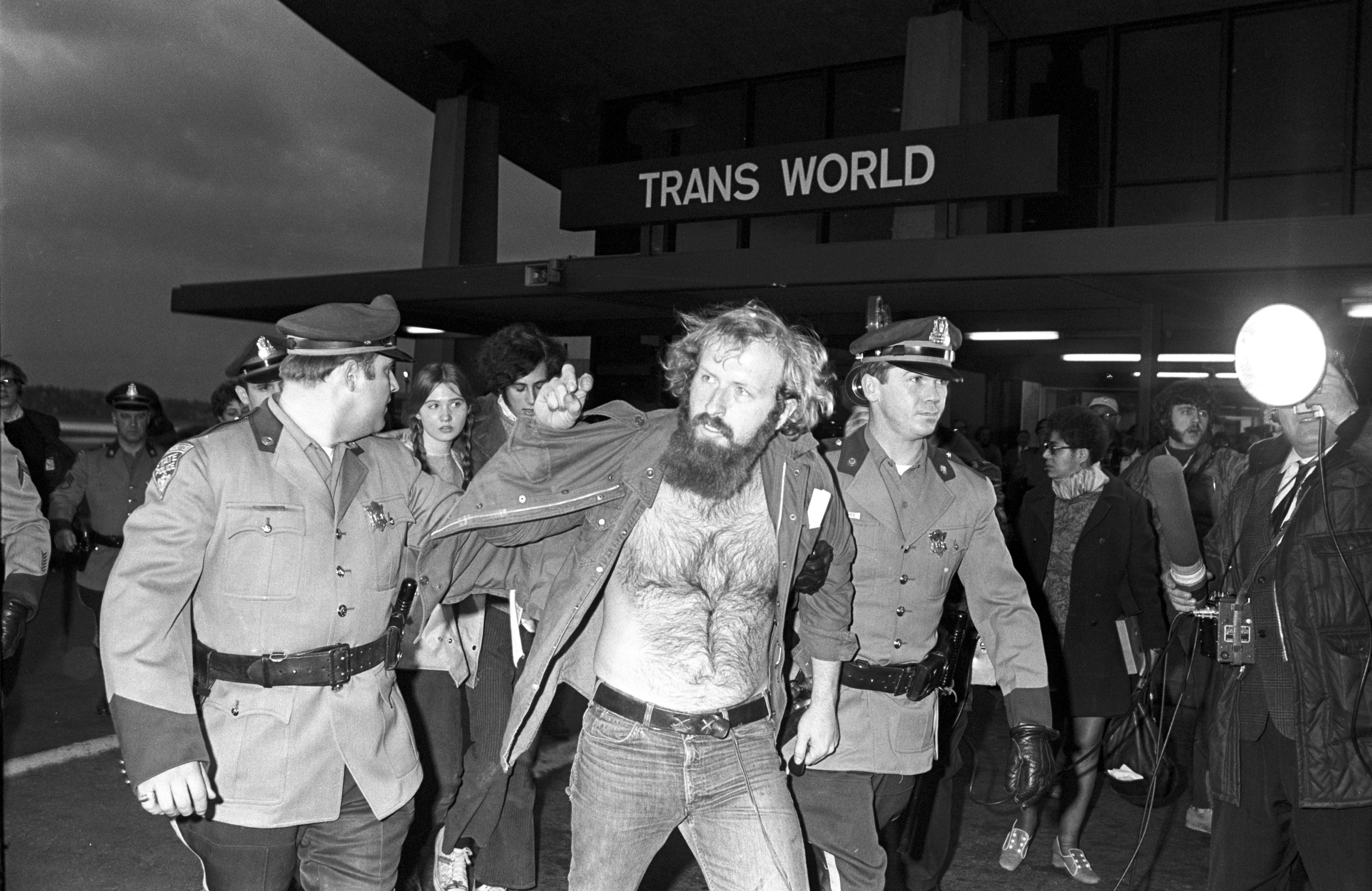 Police arrest a protestor during an Earth Day demonstration at Boston's Logan Airport, August, 1970.