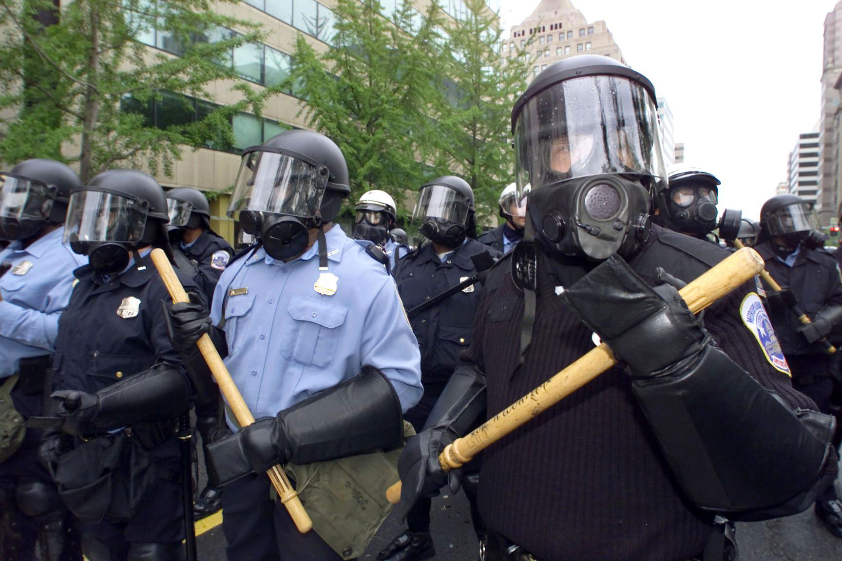 Washington D.C. police officers gather outside the World Bank as protesters mass, April, 2000.