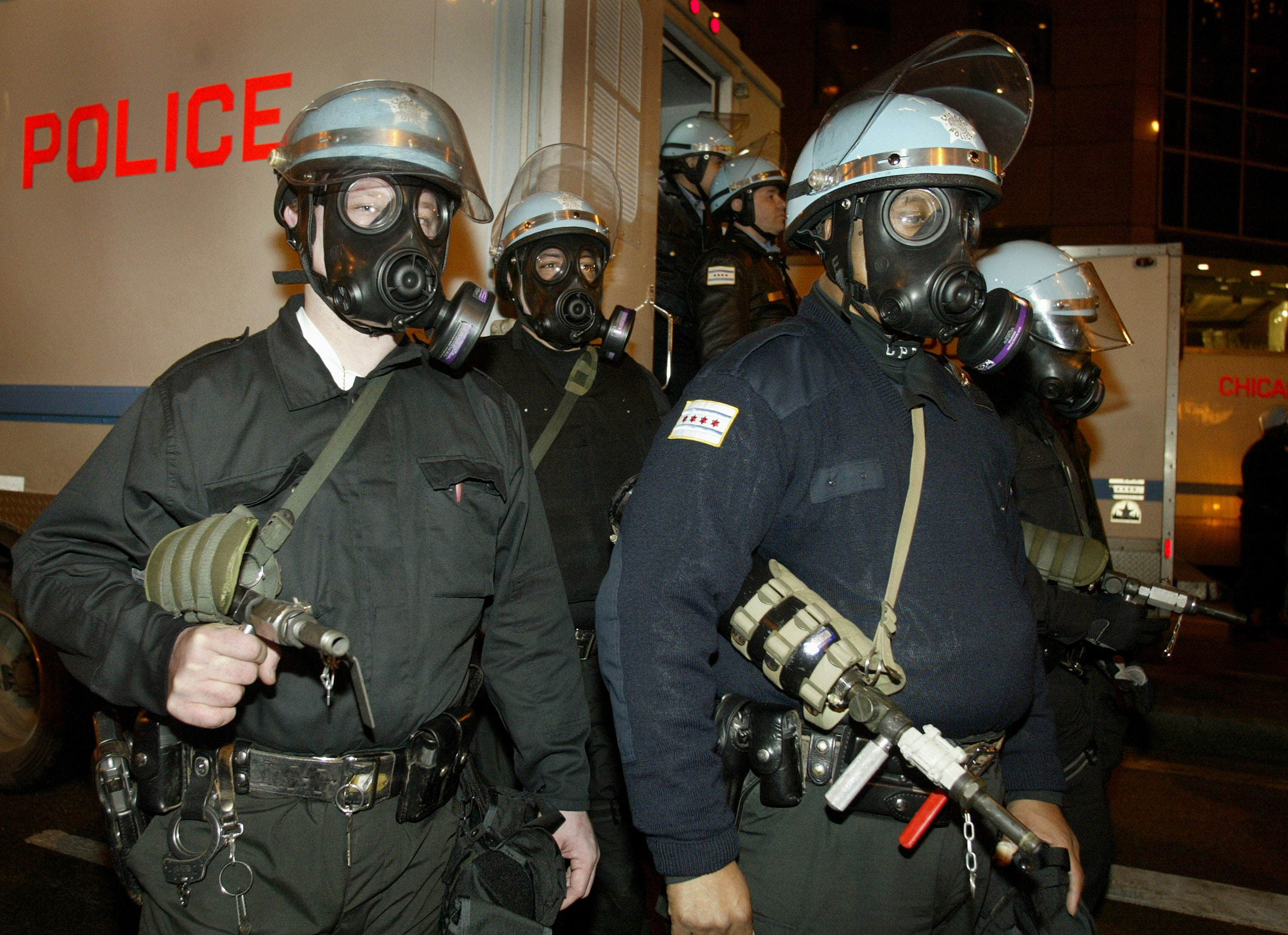 Police in riot gear and armed with pepper spray at an anti-war protest in Chicago, March, 2003.
