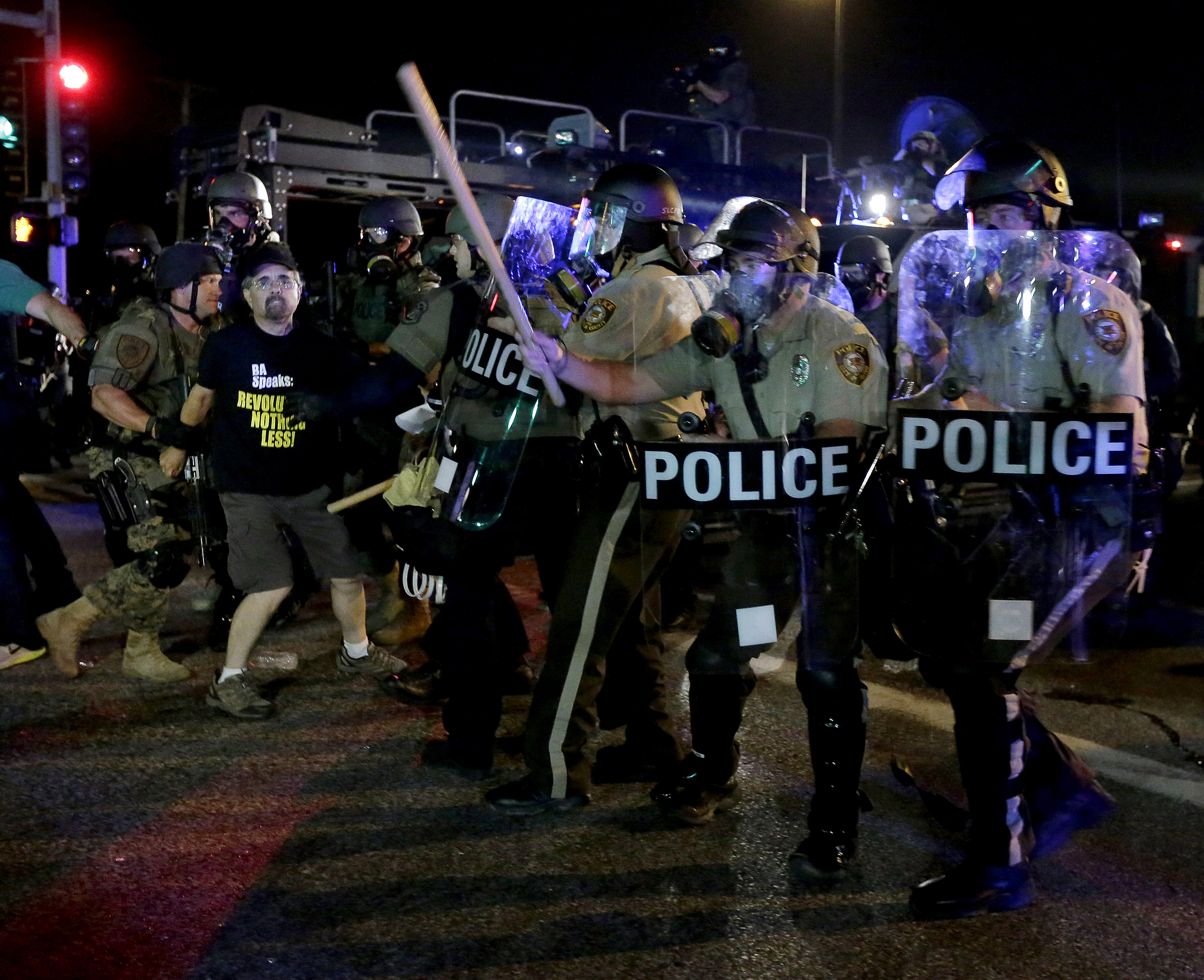 A man is detained after a standoff between protesters and police on Aug. 18, 2014 in Ferguson, Mo.