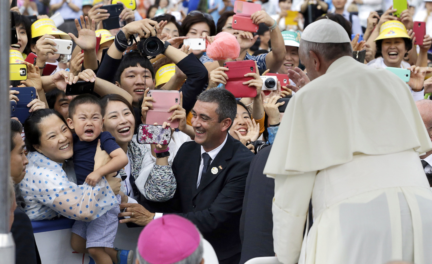 The Pope gives his blessings as he arrives Aug. 17 for a Mass in the town of Haemi, south of South Korea's capital, Seoul