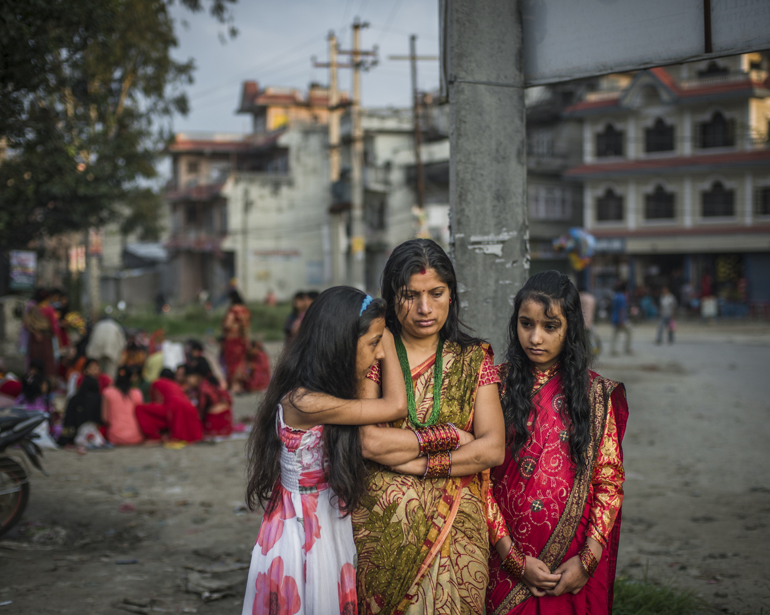 A mother and her daughters as they observe the ritual of Rishi Panchami. Kathmandu.