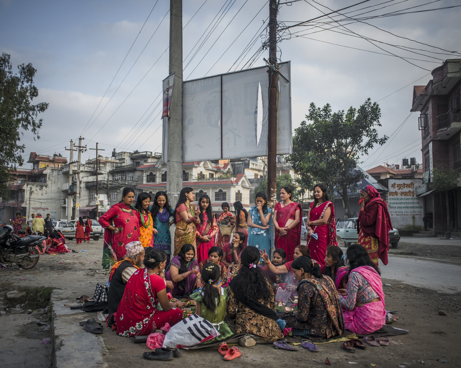 A group of women gather for final prayers during Rishi Panchami. Kathmandu.