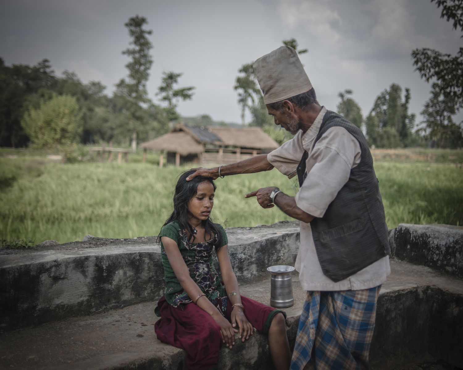 Traditional healers often use extreme verbal and physical abuse to heal young girls who are ill during menstruation, believing they are possessed by an evil spirit. Surkhet District.