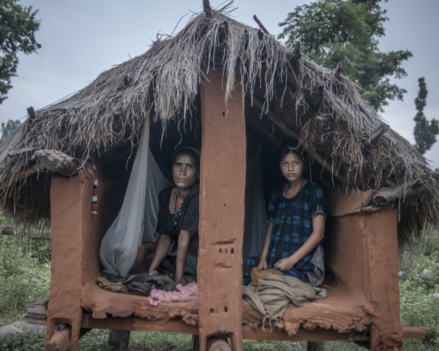 Chandra Tiruva, 34, and Mangu Bika, 14, in a shed in Surkhet District.
