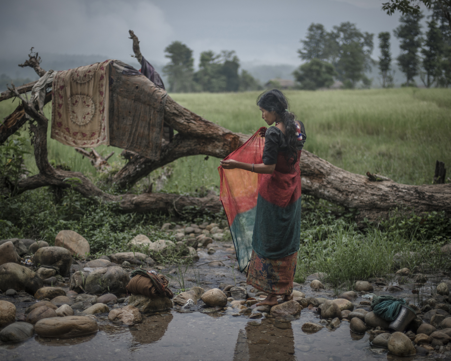 Most menstruating women are not allowed to bathe. In certain villages, the luckier women can begin to do so several days into their cycles. Surkhet District.