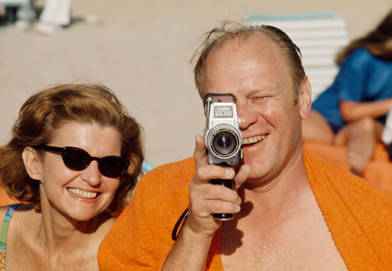 President Ford and First Lady Betty chose Mauna Kea Beach, Hawaii on the Big Island for a getaway vacation in 1974, but they couldn't escape the prying eyes of the press. Here, the president, a former All American football player at Michigan, turned his movie camera on a familiar photographer.