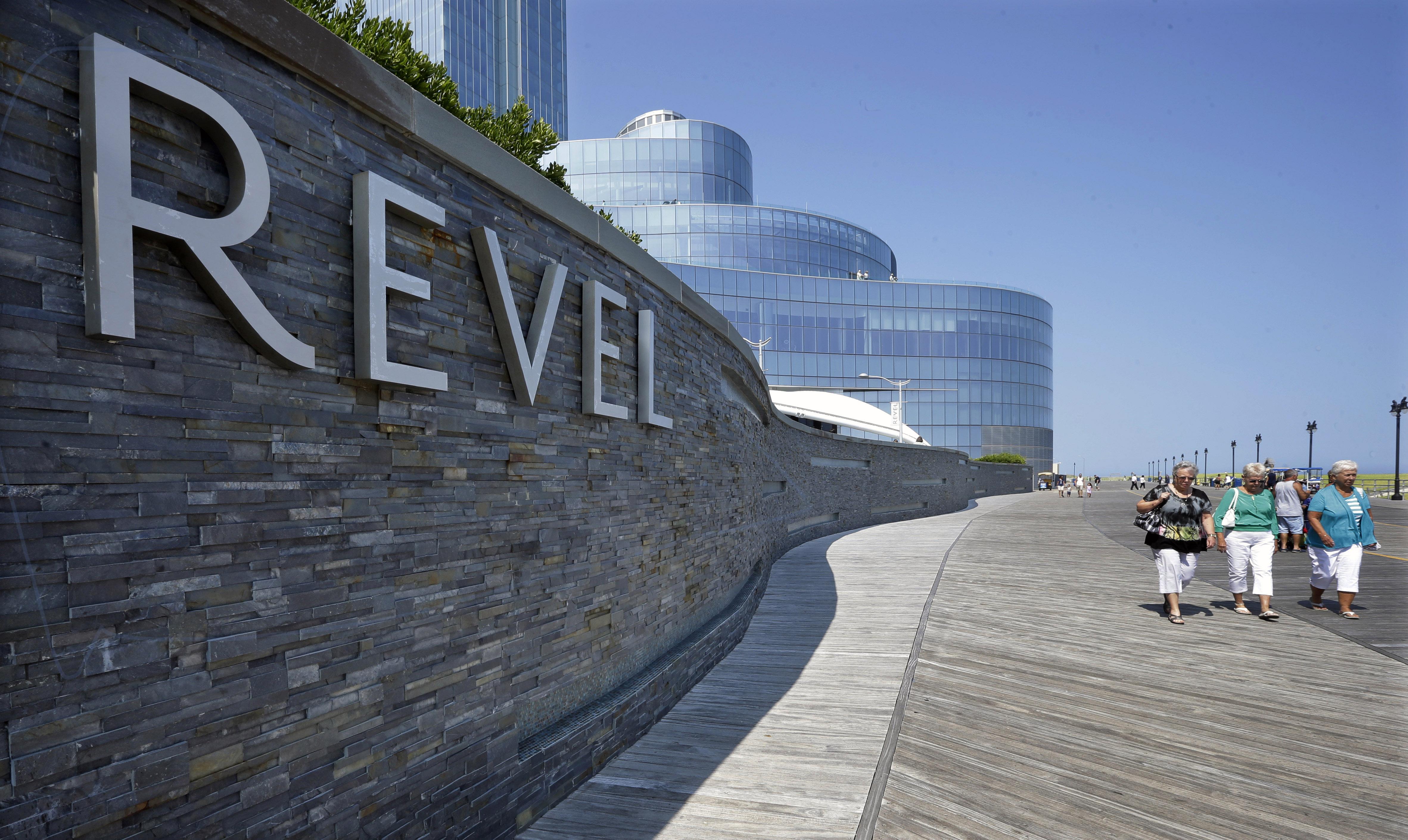 People walk past the Revel Casino Hotel in Atlantic City, N.J. on July 23, 2014.
