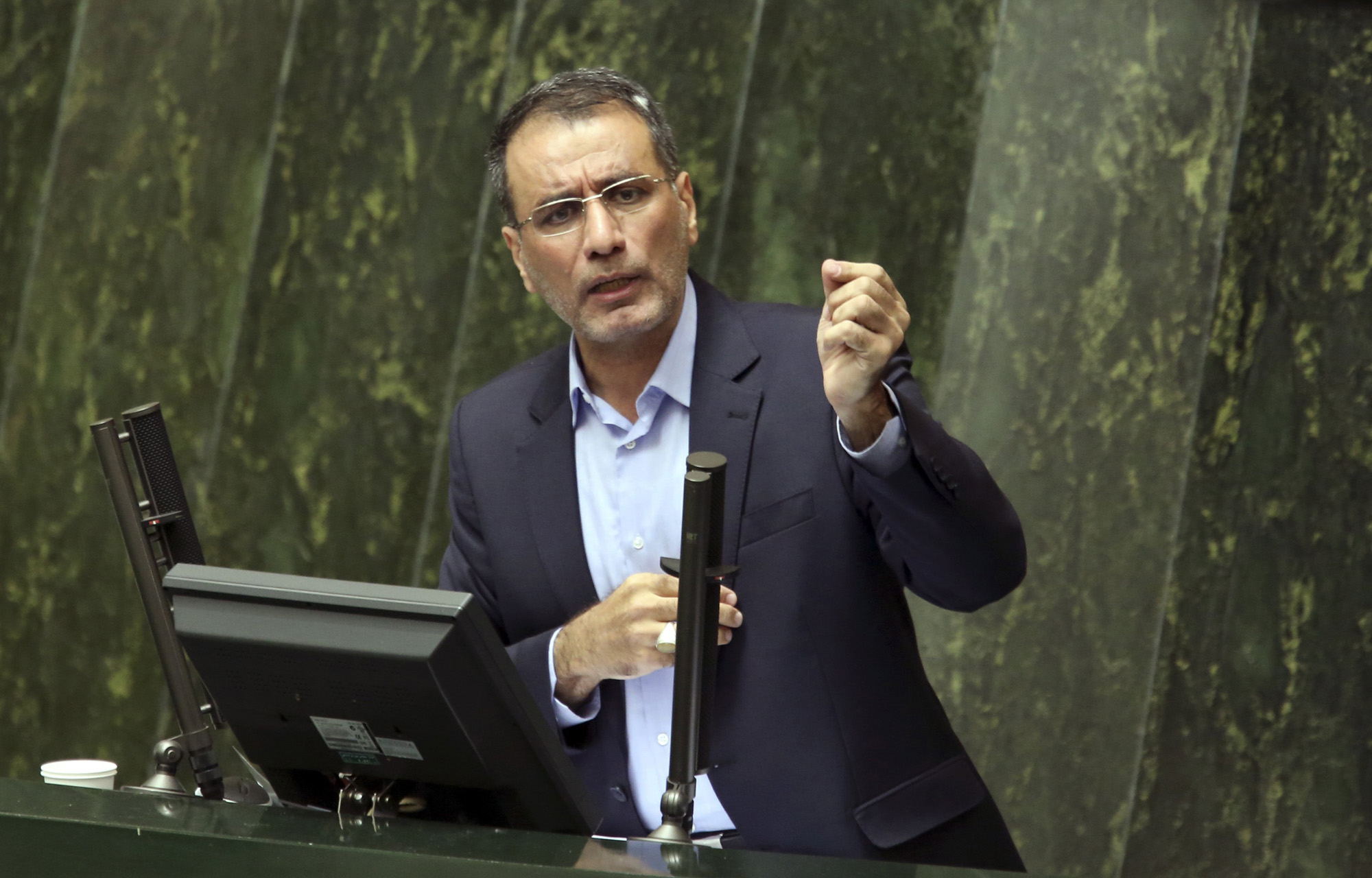 Iran's Science, Research and Technology Minister Reza Faraji Dana speaks during his impeachment in an open session of the parliament in Tehran, Aug. 20, 2014.