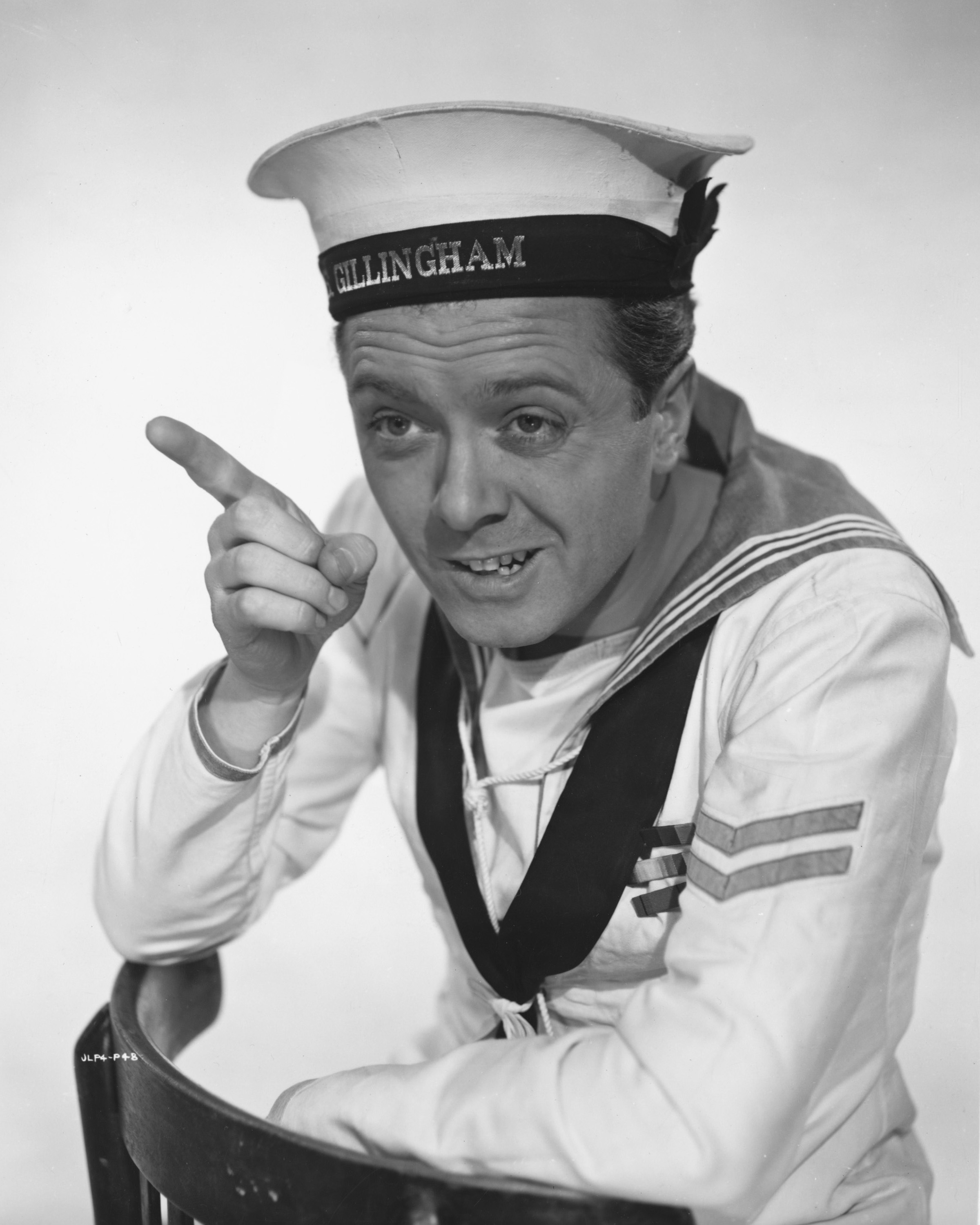 Richard Attenborough as Knocker White in a promotional portrait for The Baby and the Battleship in 1956.