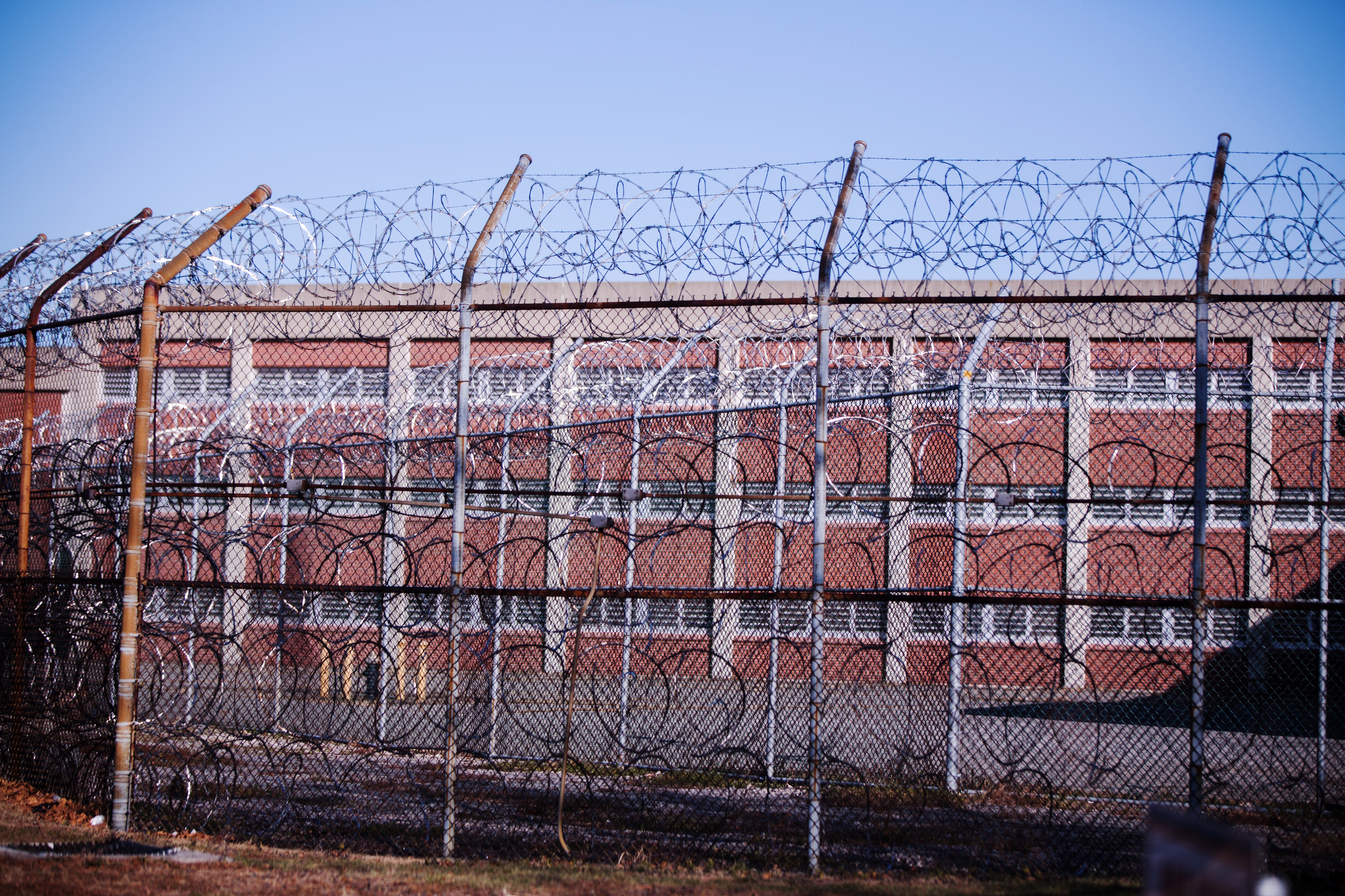 Barbed wire fences surround a building on Rikers Island Correctional Facility in New York on Dec. 24, 2013.
