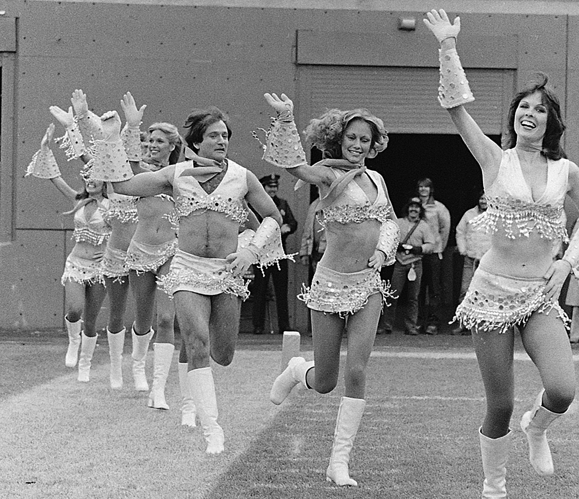 "Robin Williams, third from right, dressed as a cheerleader on Nov. 12, 1979 with the Broncos' Pony Express cheerleaders during the filming of an episode of ""Mork & Mindy,"" in Denver."
