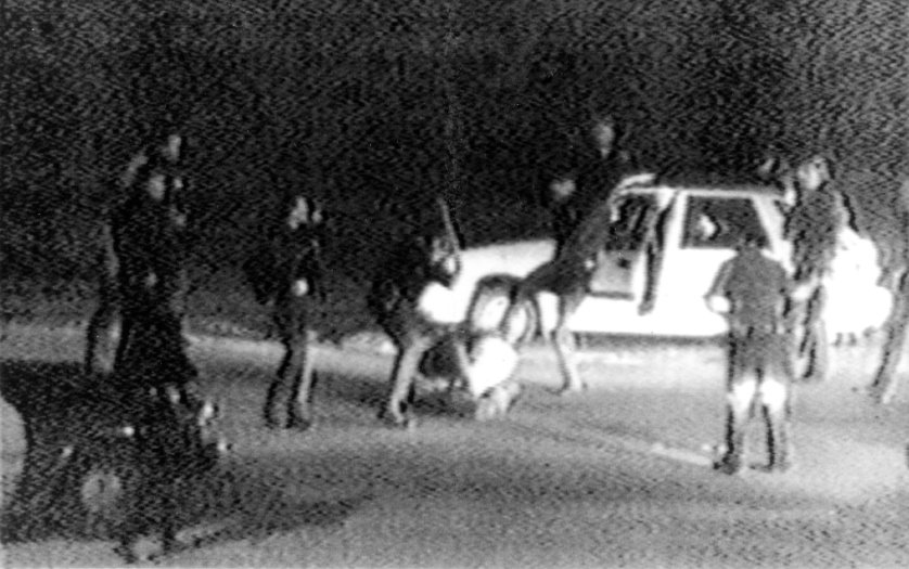 Video tape shot by George Holliday shows what appears to be a group of police officers beating Rodney King with nightsticks and kicking him as other officers look on. Los Angeles. United States. March 3, 1991.