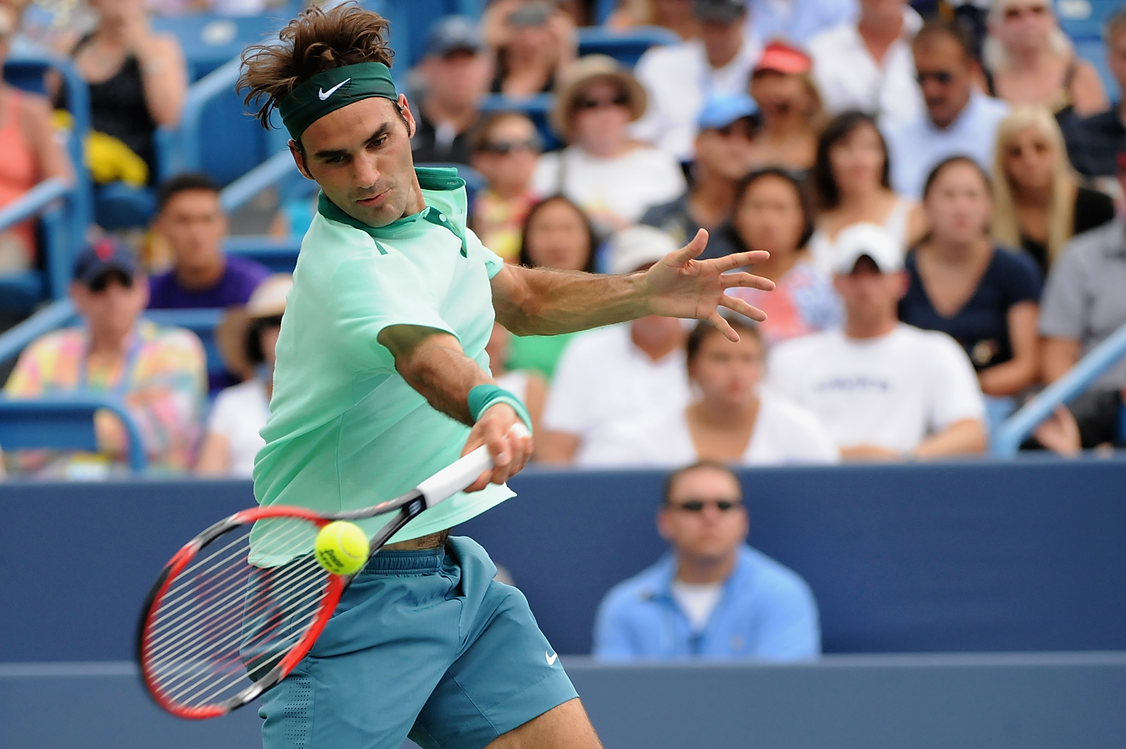 Roger Federer of Switzerland returns to David Ferrer of Spain during a final match on Day 9 of the Western & Southern Open at the Linder Family Tennis Center in Cincinnati on Aug. 17, 2014