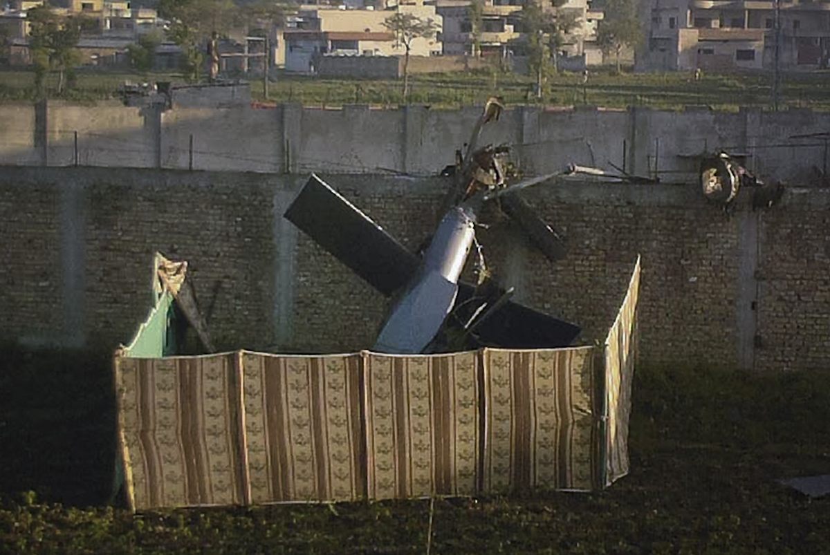 The tail of a downed Special Ops helicopter inside bin Laden's compound in Pakistan in 2011. The pilots who led that successful mission belonged to a unit created because of a failed rescue effort in Iran 31 years earlier.