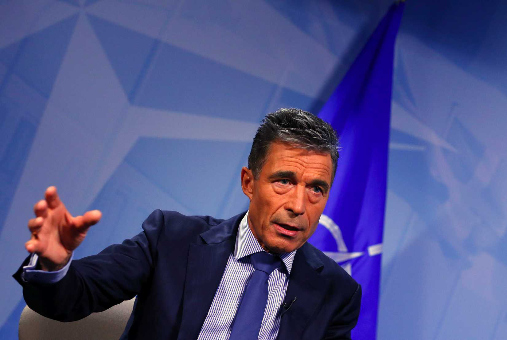 NATO Secretary General Anders Fogh Rasmussen speaks during an interview with Reuters in Brussels on August 11, 2014