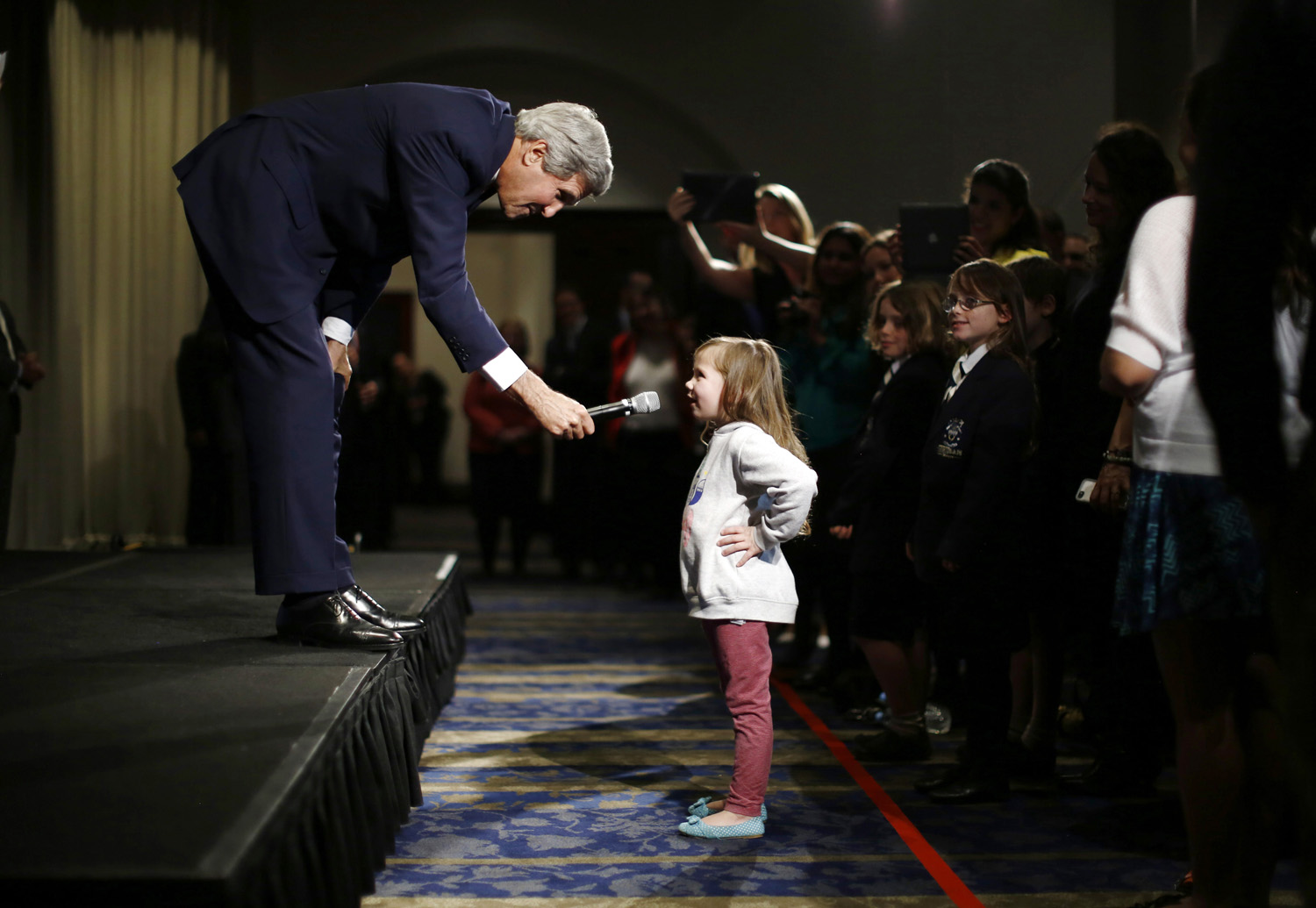 U.S. Secretary of State John Kerry speaks with five-year-old Dara Edwards, the daughter of an American staffer at the U.S. Consulate in Sydney, as he meets embassy and consular staff in Sydney on August 12, 2014.