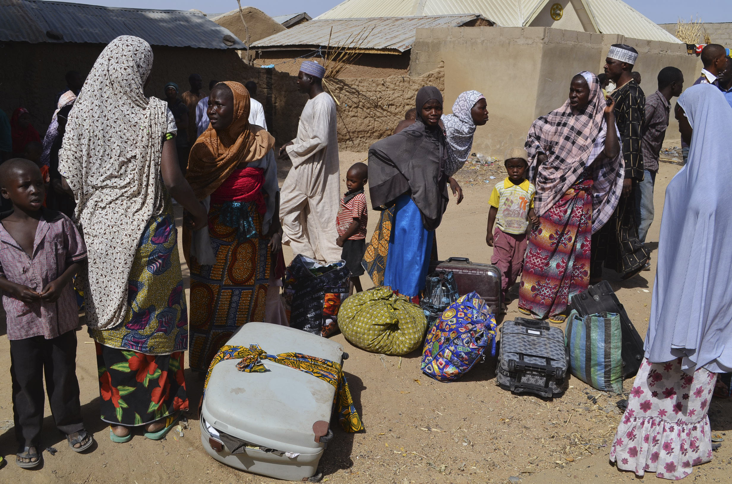 In this Feb. 18, 2014 photo, families from Gwoza are pictured at a refugee camp in Mararaba Madagali, Adamawa State after being displaced by the violence and unrest caused by the insurgency.