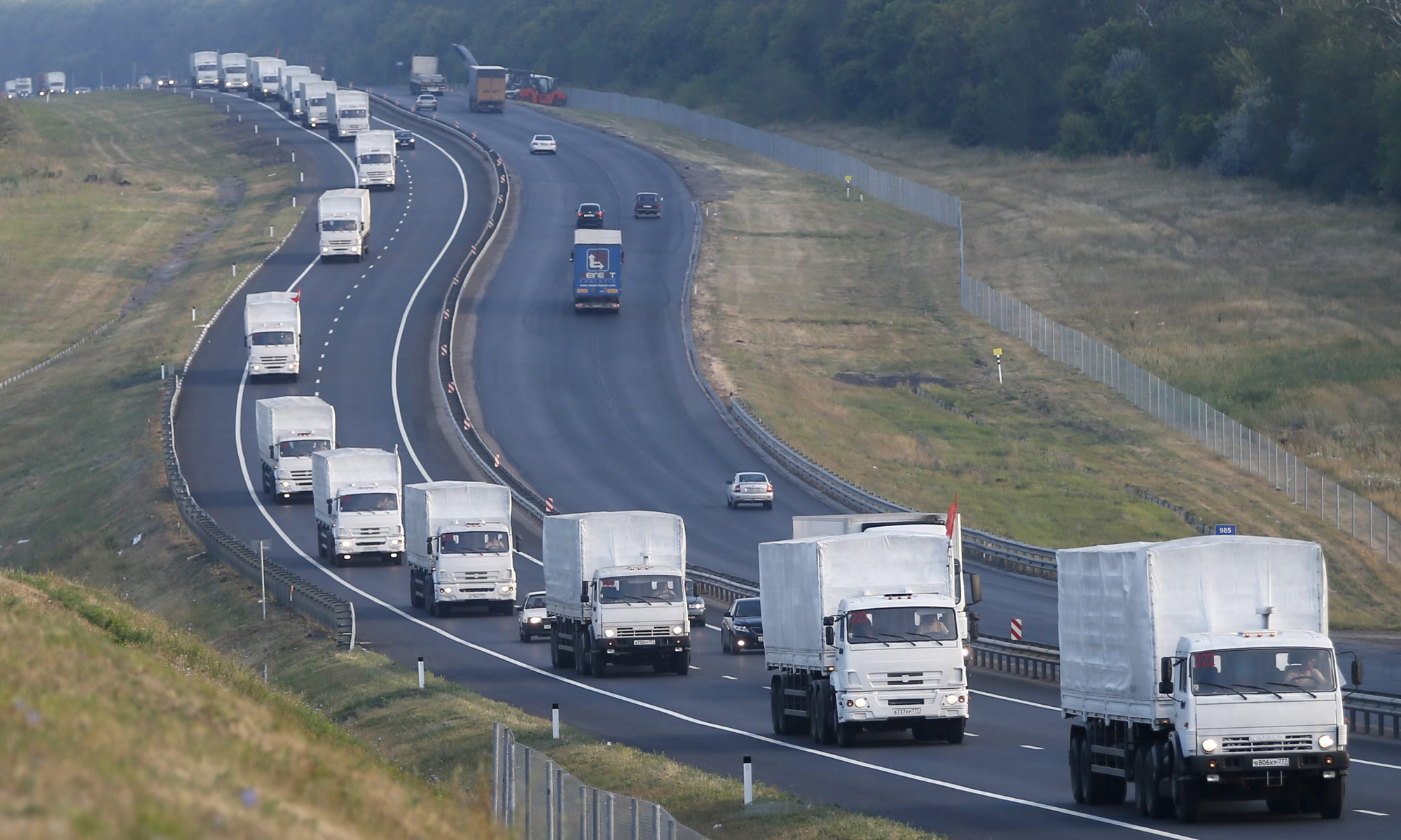 A Russian convoy carrying humanitarian aid for residents in rebel eastern Ukrainian regions moves along a road about 30 miles from Voronezh, Russia, Aug. 14, 2014.