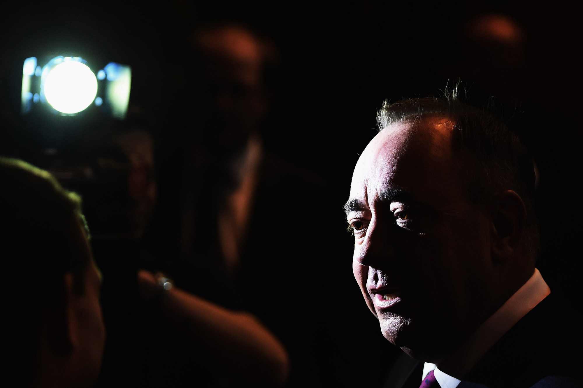 Alex Salmond, First Minister of Scotland, talks the media after debating with Alistair Darling chairman of Better Together in a televised event from the Royal Conservatoire of Scotland on August 5, 2014 in Glasgow, Scotland.