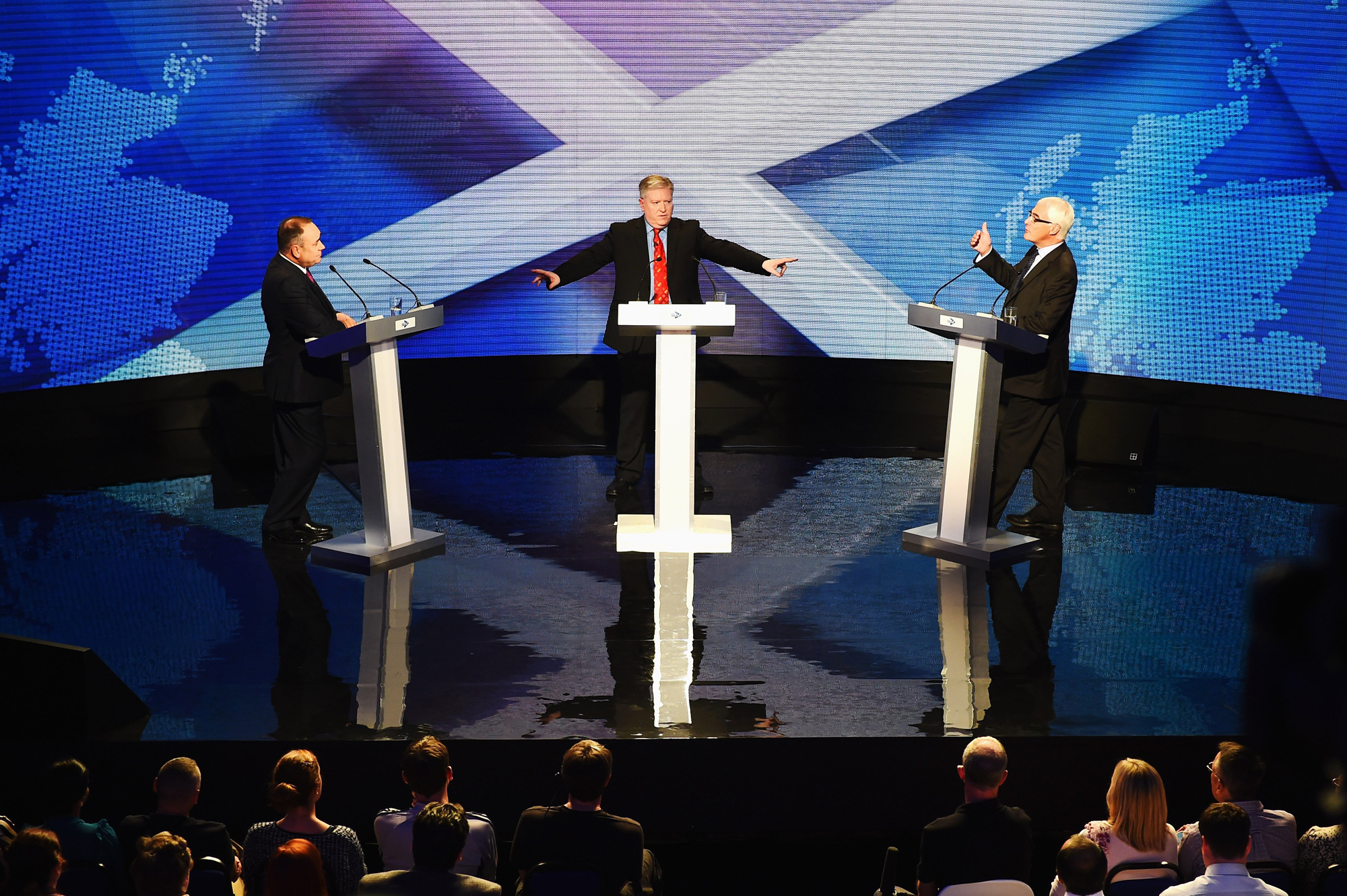 Alex Salmond, First Minister of Scotland and Alistair Darling, chairman of Better Together take part in a live television debate hosted by Bernard Ponsonby at the Royal Conservatoire of Scotland on August 5, 2014 in Glasgow, Scotland.