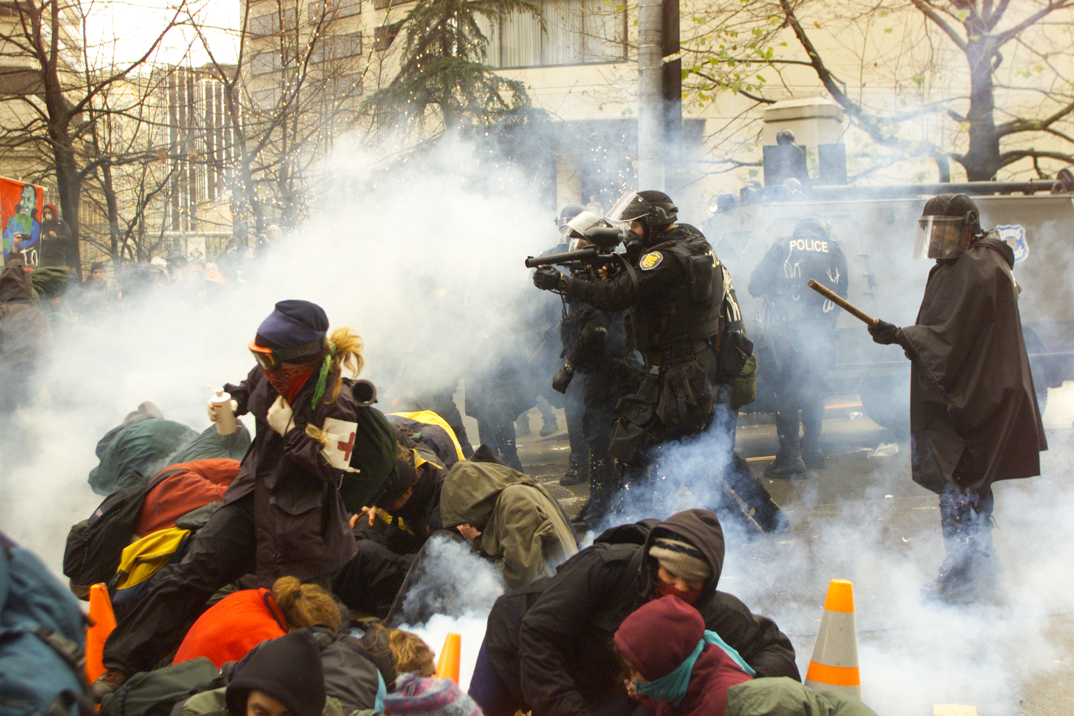 Seattle police fire teargas and pellets at protesters outside the World Trade Organization conference in Seattle, Washington on November 30, 1999.