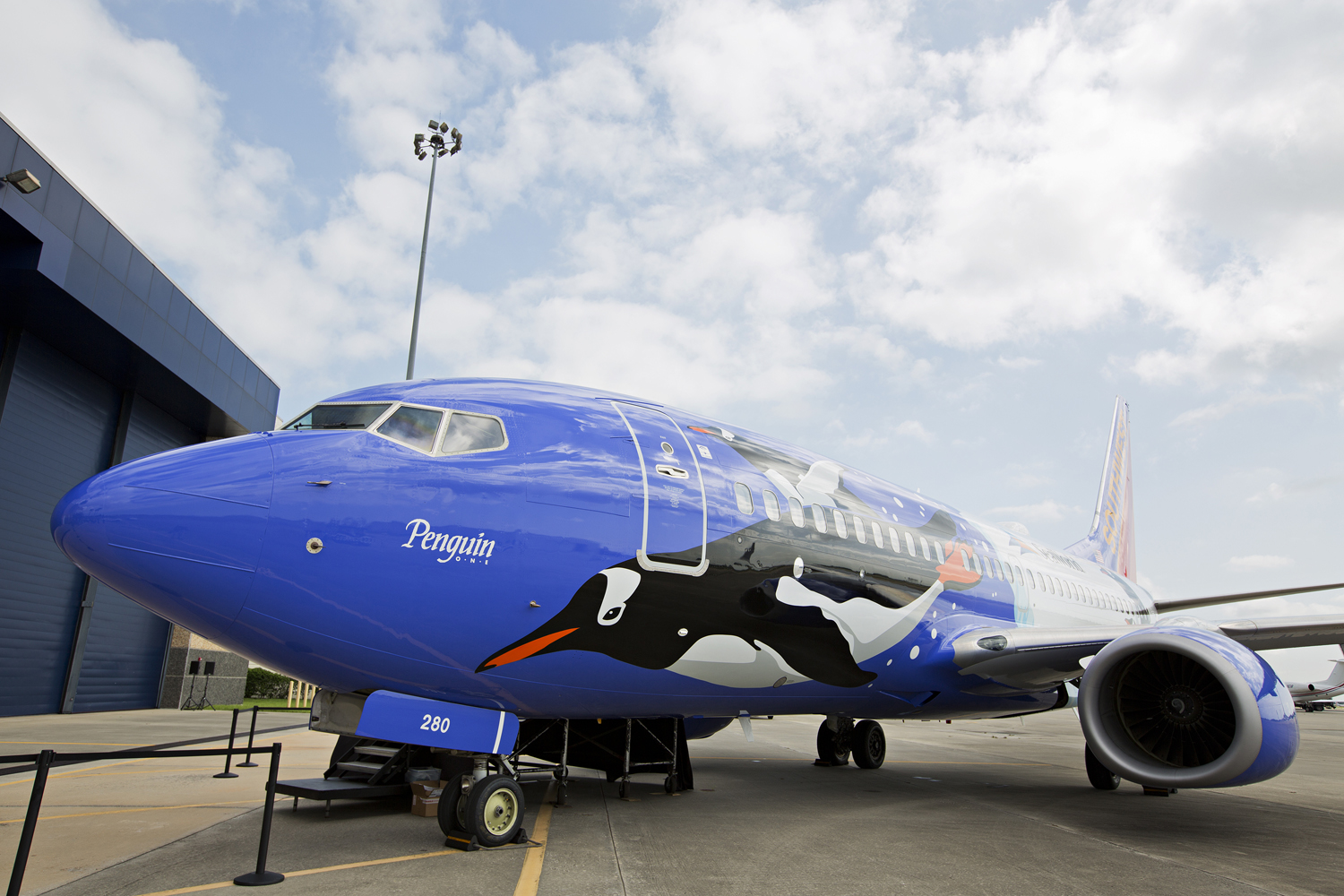 Southwest Airlines debuts its newest specialty plane, Penguin One, in celebration of 25 years of partnership with SeaWorld on June 20, 2013