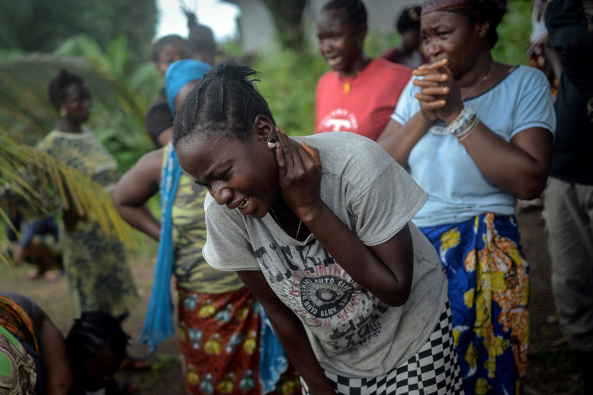 Relatives of an Ebola victim mourn in Lango village, Kenema, Sierra Leone on Aug. 25, 2014.