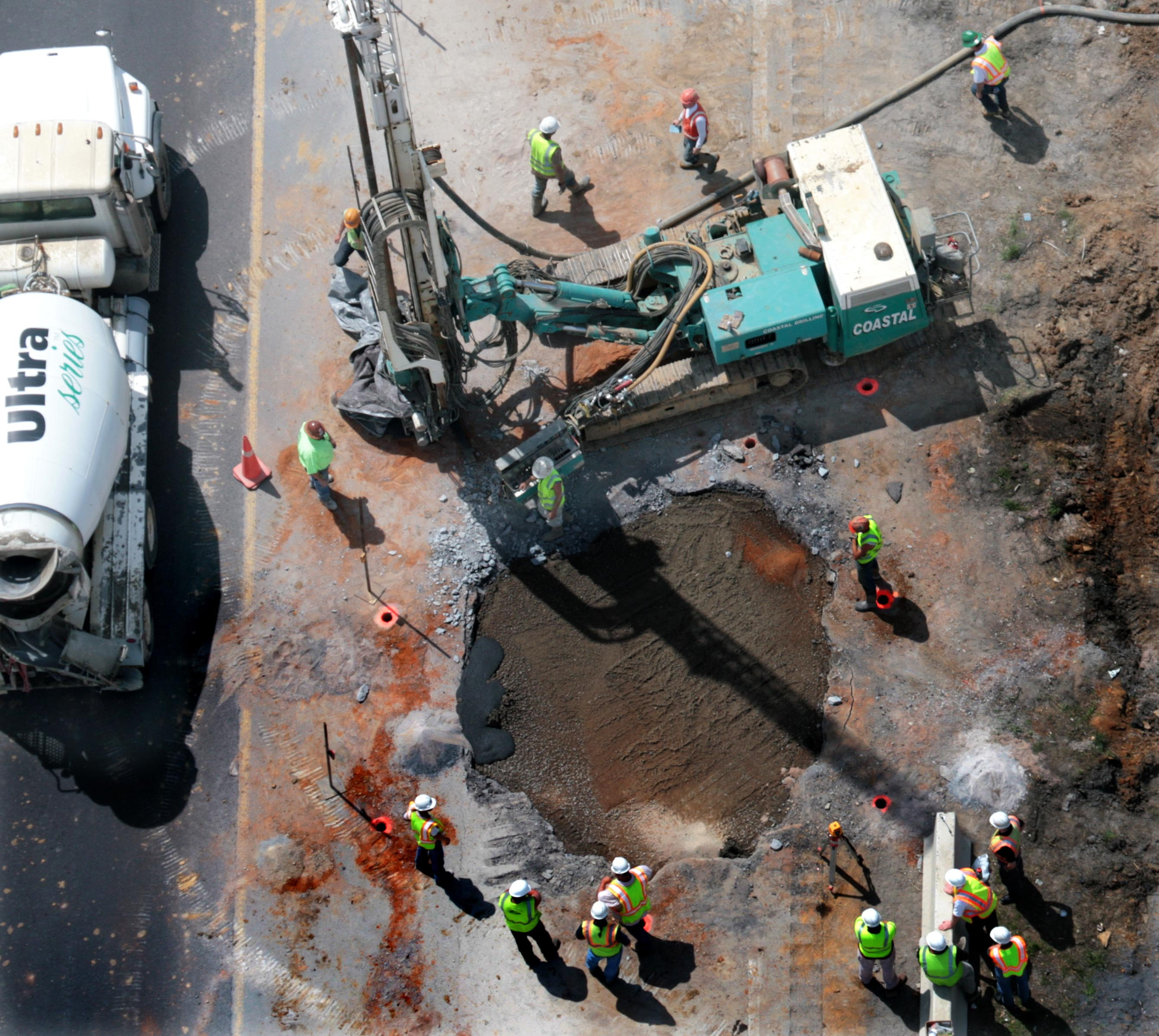 An Aerial view looking down on a sinkhole as traffic passes in Frederick, Maryland on April 24, 2008.