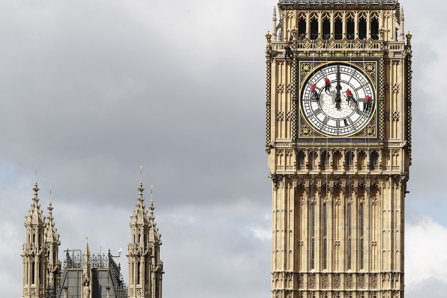 Aug. 19, 2014. A team of technical specialist clean and inspect one of the four faces of the Great Clock, otherwise known as Big Ben, at the Houses of Parliament, in central London.