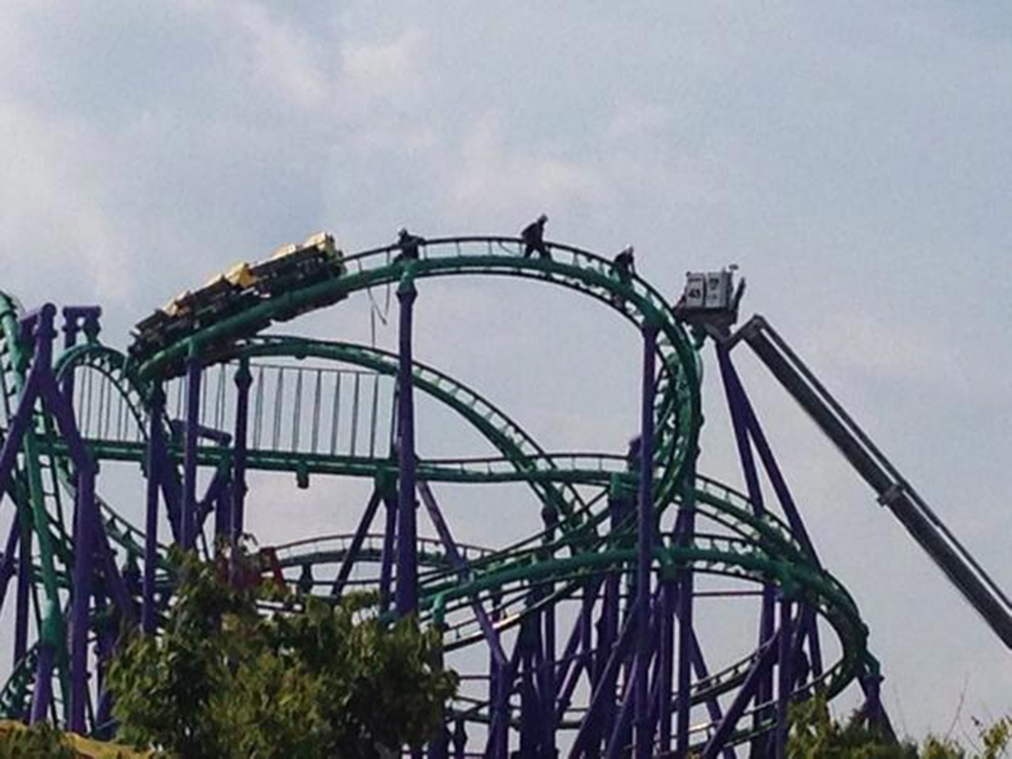 Firefighters rescuing 24 riders stuck atop the Joker's Jinx roller coaster at Six Flags   theme park in Prince George's County, Maryland on August 10, 2014.