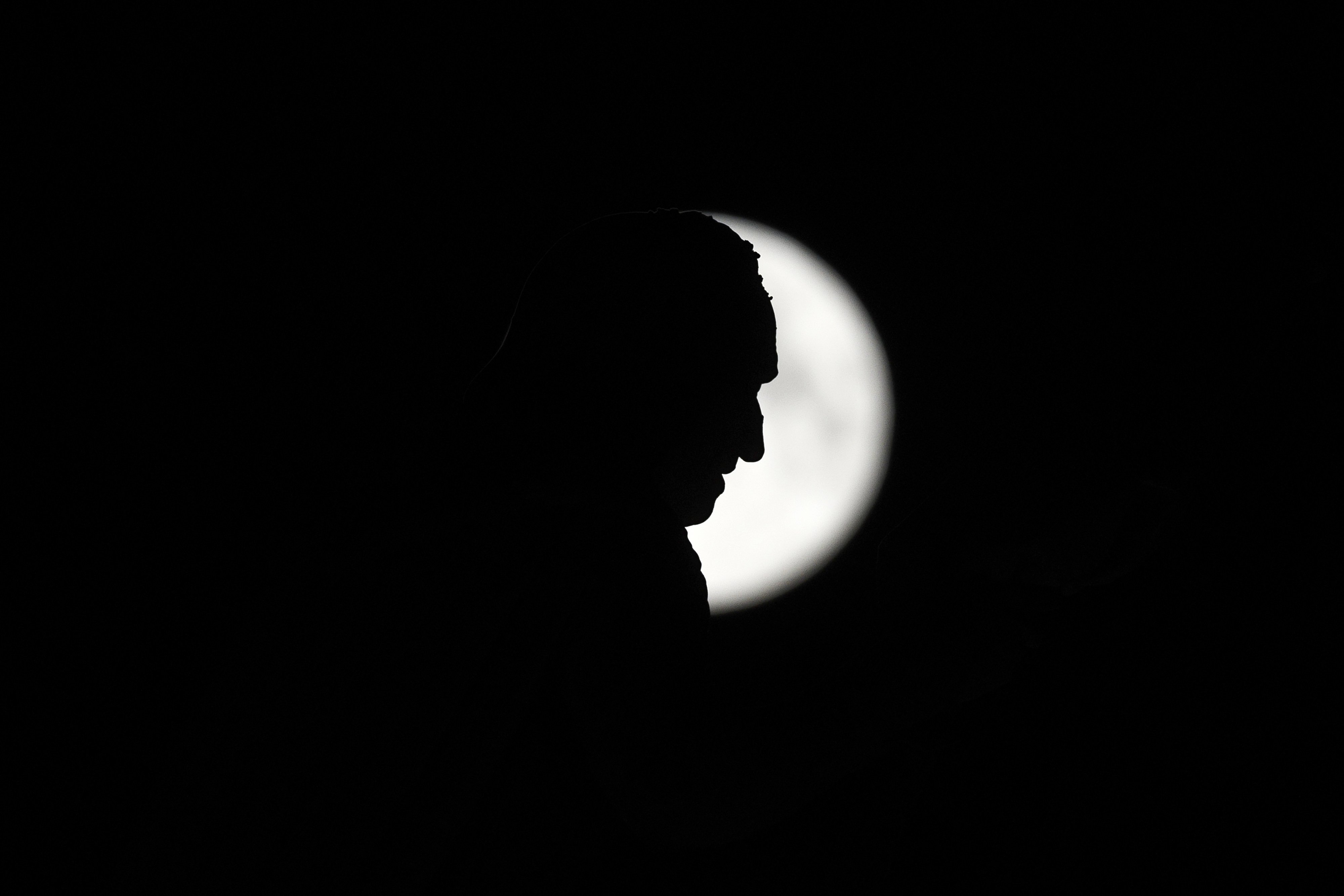 A monument to Christopher Columbus stands against the perigee moon, also known as a supermoon, in Madrid on August 10, 2014.