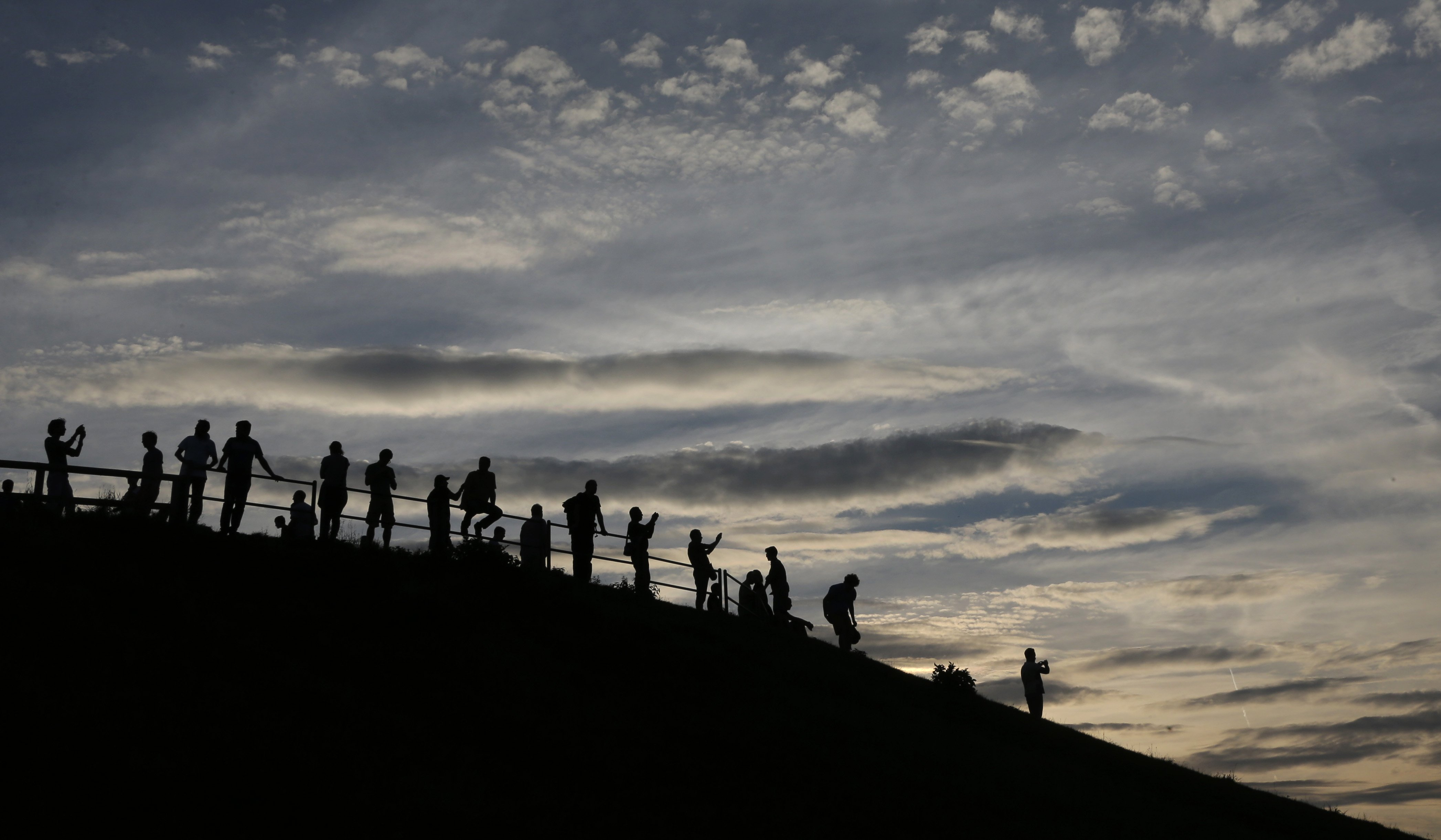 People wait for the upcoming Super Moon in the Olympic Park in Munich, Germany on August 10, 2014.