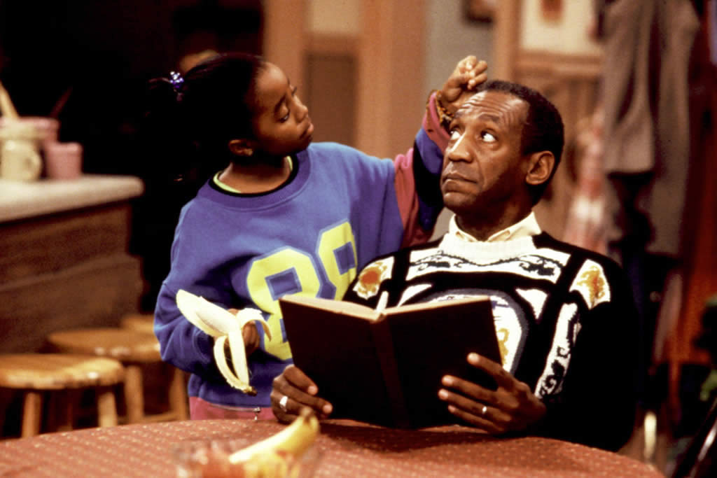 Bill Cosby as Cliff Huxtable, with daughter Rudy (Keshia Knight Pulliam), on  The Cosby Show