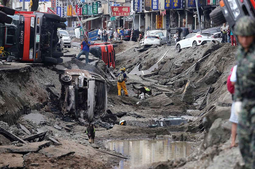 Rescue personnel survey the wreckage after an explosion in Kaohsiung, southern Taiwan on Aug. 1, 2014.