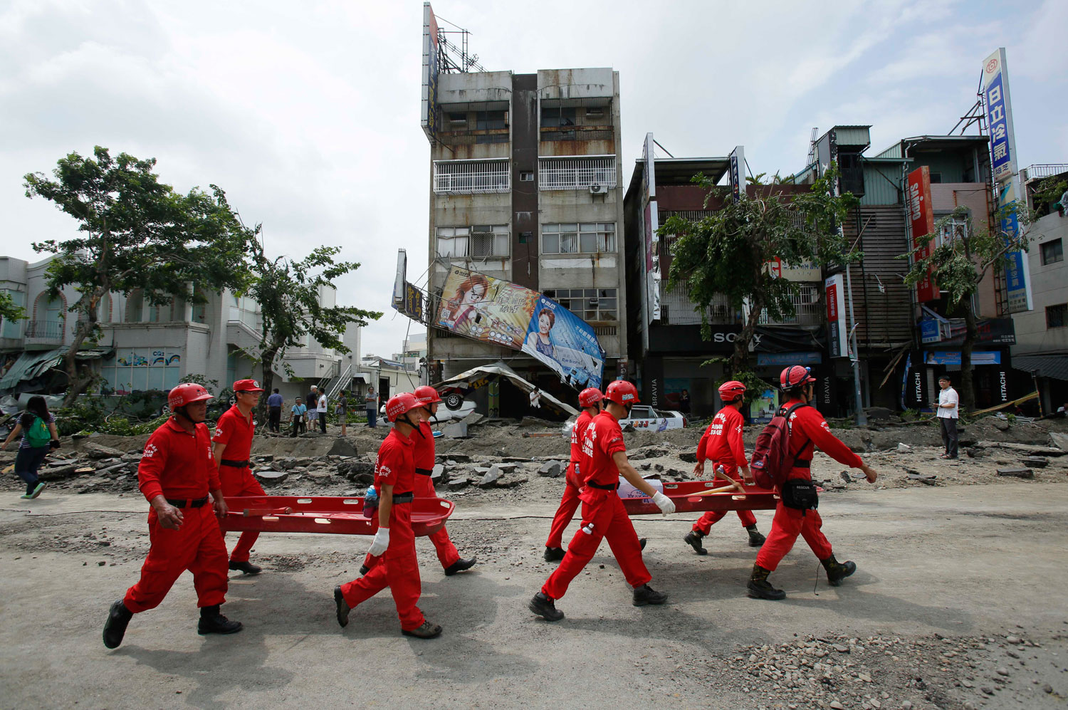Emergency rescue workers move through the damage from a massive gas explosion in Kaohsiung, Taiwan on Aug. 1, 2014.
